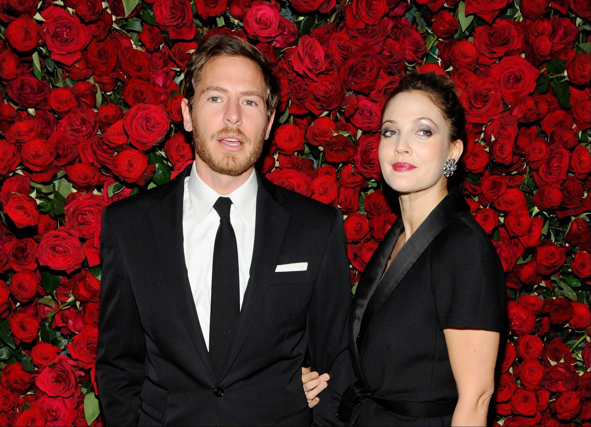 Actress Drew Barrymore, right, and husband Will Kopelman are expecting their second child.
