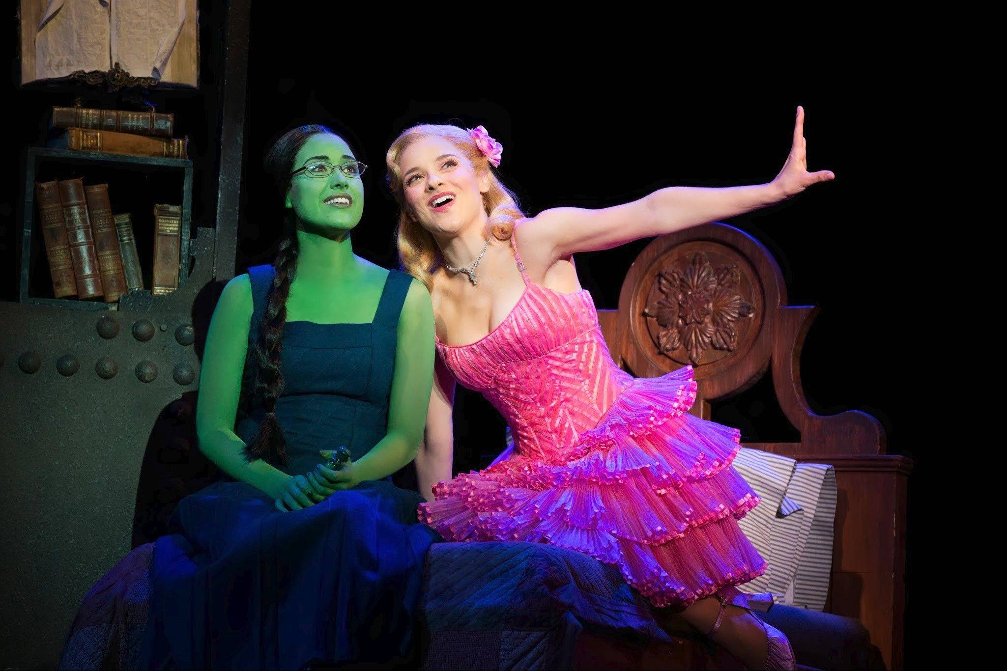 "Glinda (Jenn Gambatese, right) gives advice to Elphaba (Alison Luff) on how to be ""Popular"" in the 10th anniversary national tour of ""Wicked,"" playing at the Oriental Theatre in Chicago through Sunday, Dec. 21."