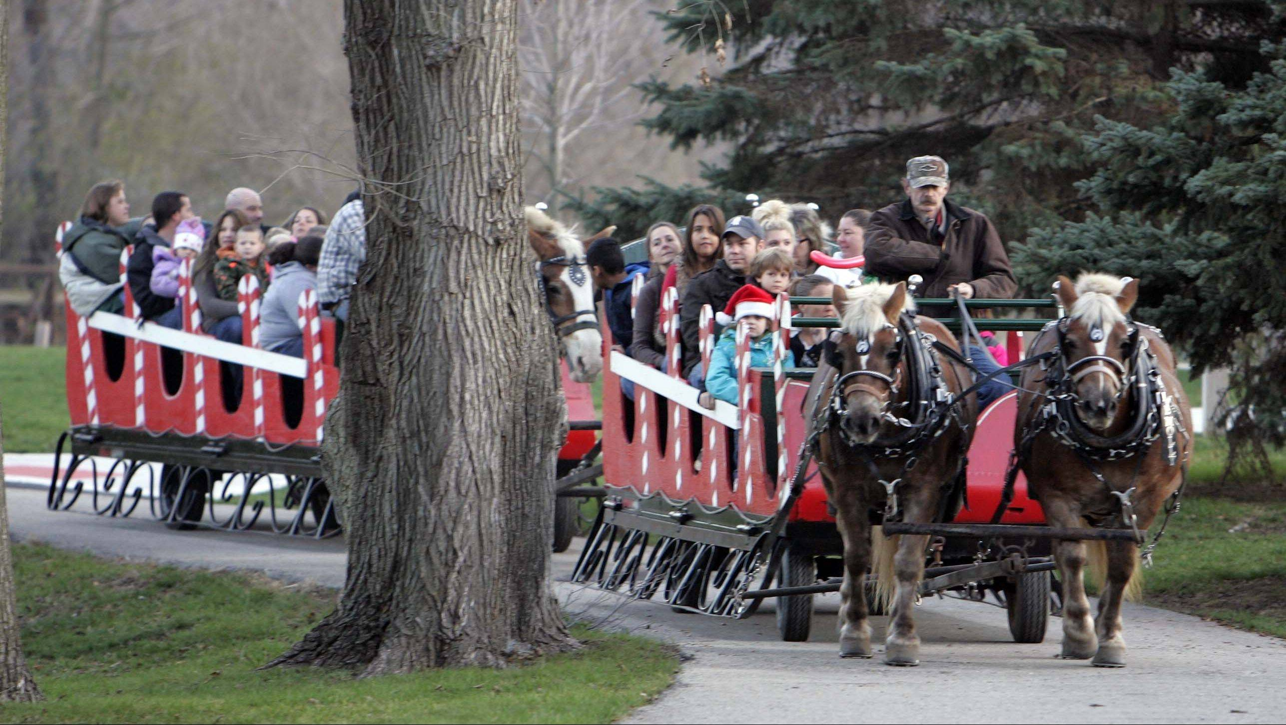 Sleigh rides wend through the park during An Almost Winter Day at SEBA Park in South Elgin.