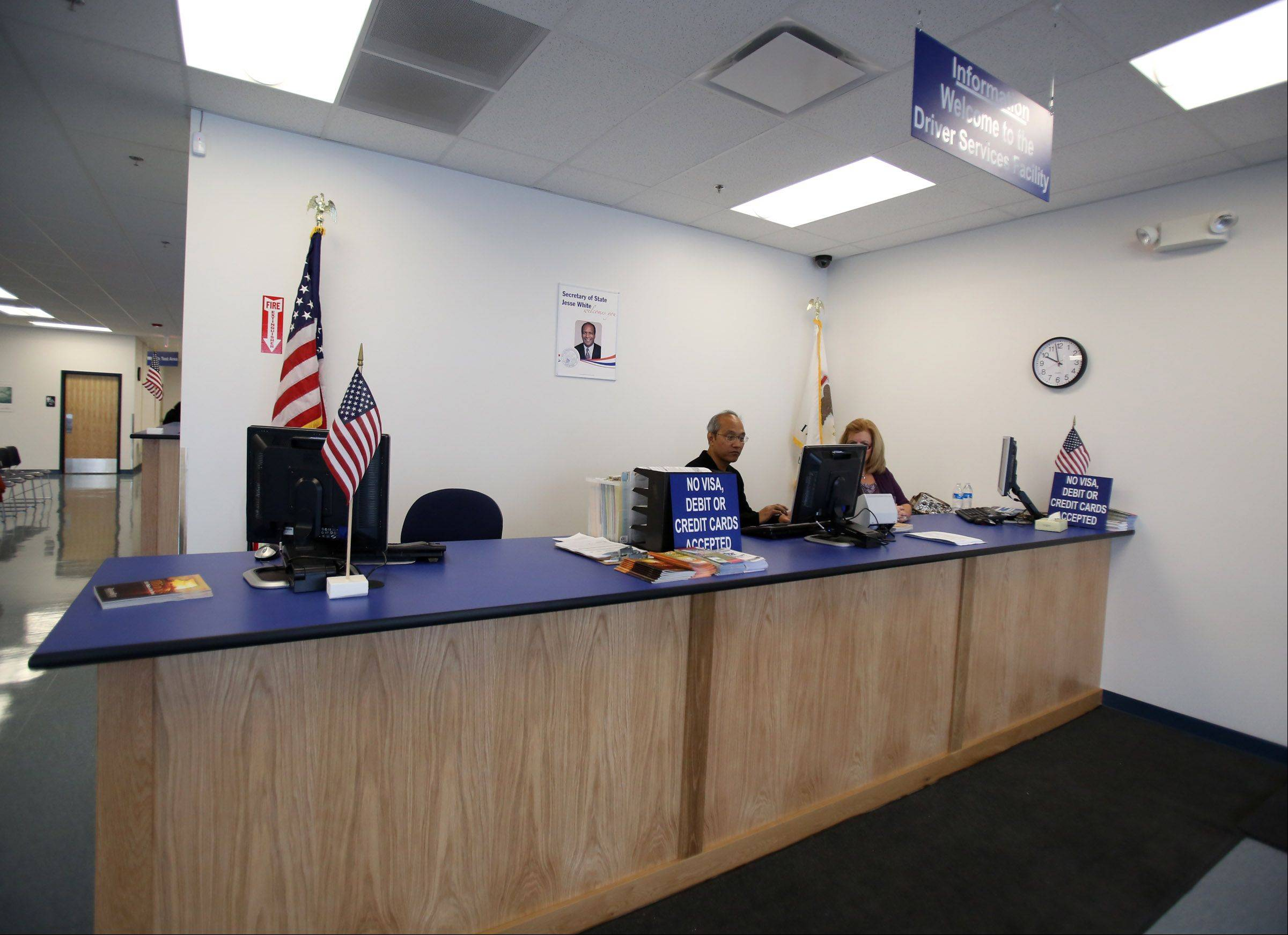 Employees at the new secretary of state driver services facility in Des Plaines wait to help patrons on Tuesday during the office's soft opening.