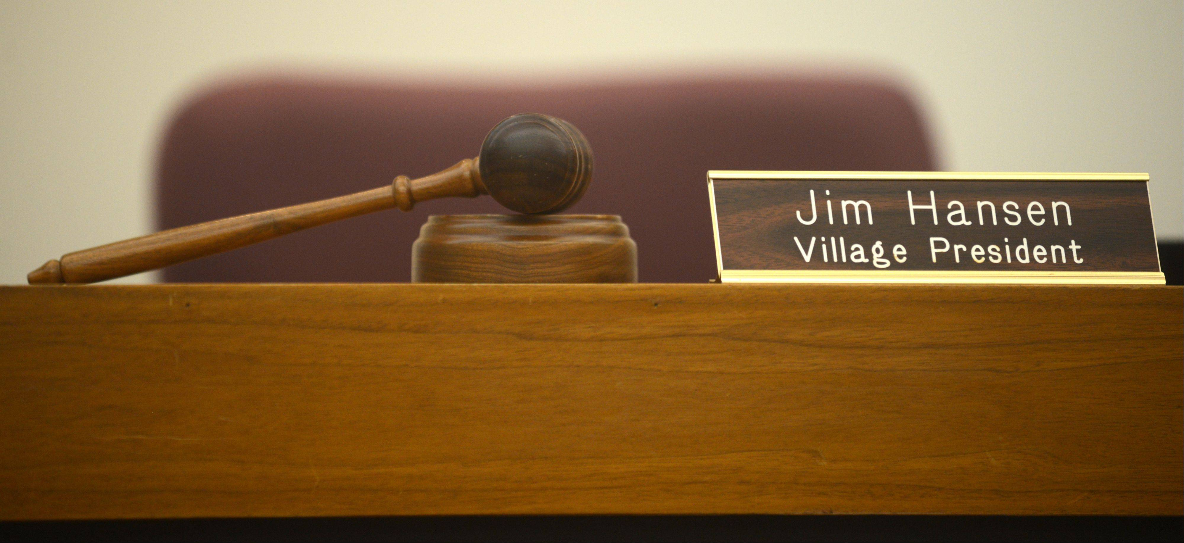 Village President Jim Hansen was remembered during a village board meeting in South Elgin on Monday night. Hansen died over the weekend after a battle with cancer. A gavel and nameplate accompanied Hansen's vacant seat.