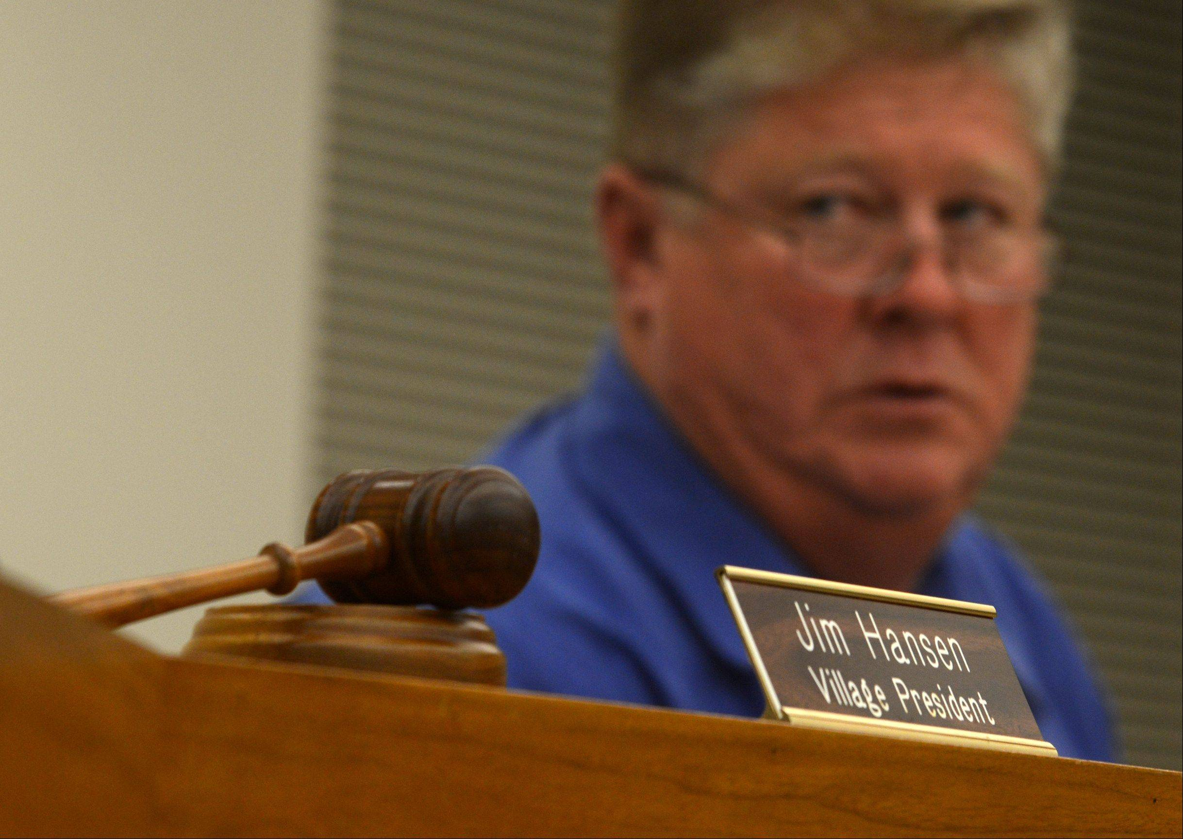 Village President Jim Hansen was remembered during a village board meeting in South Elgin on Monday night. Here, acting President for Monday night's meeting Trustee John Sweet looks past Hansen's vacant chair.