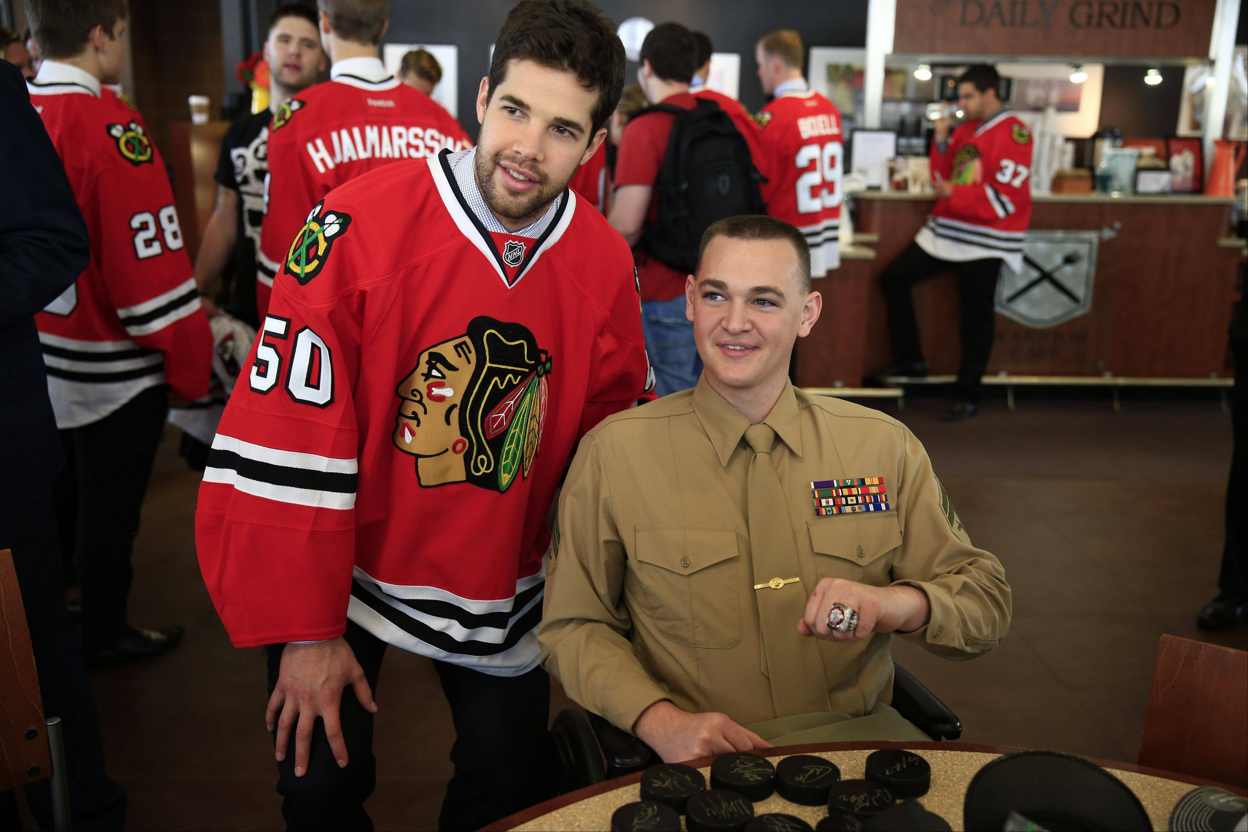 Corey Crawford and all the other Blackhawks at the Walter Reed National Military Medical Center obliged a double amputee who had a bag full of hockey pucks needing autographs.