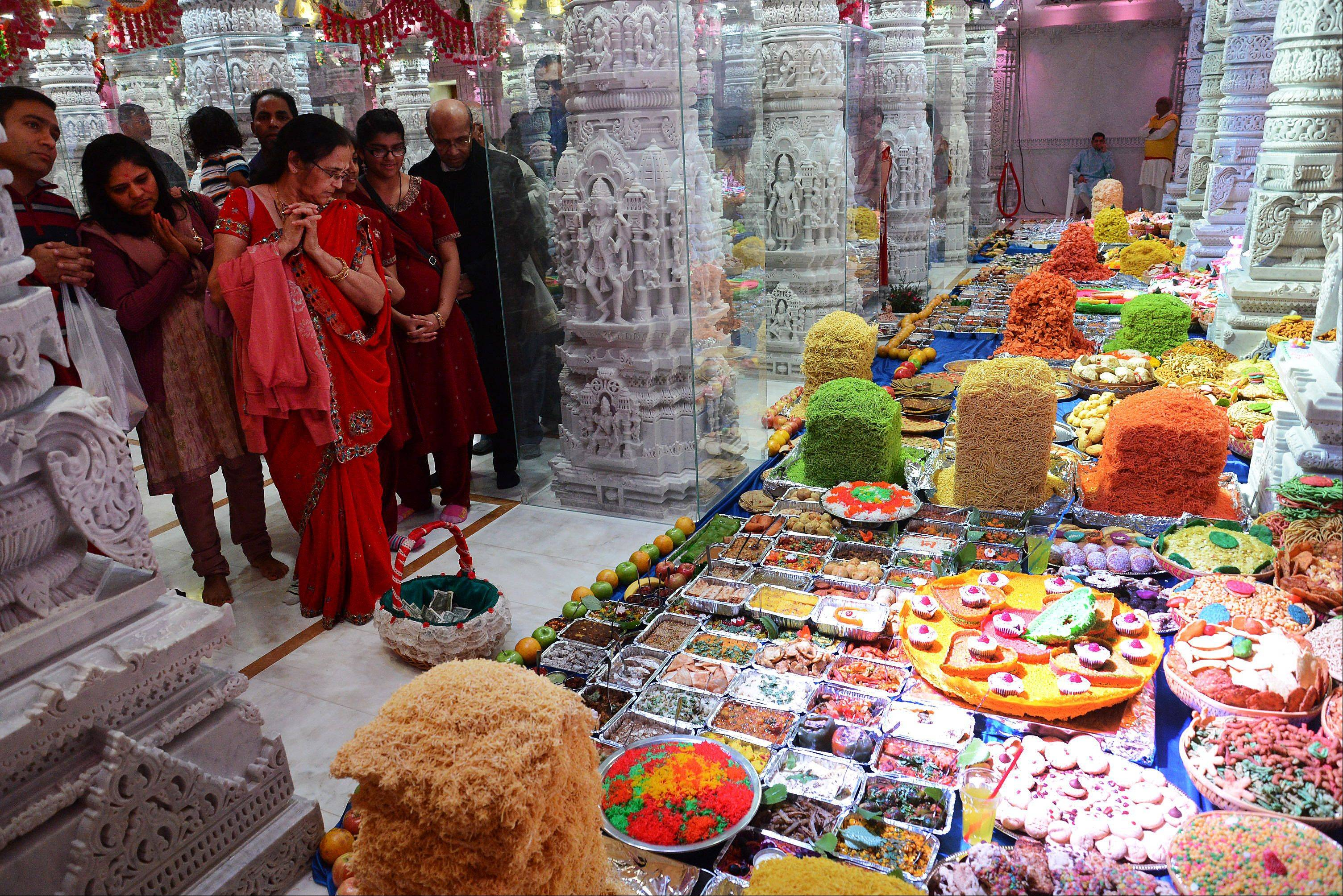 "An annakut, literally ""mountain of food,"" could be found Monday during the fourth day of Diwali celebration at BAPS Hindu Mandir in Bartlett. Hundreds of Hindus have been gathering at the temple to celebrate the new year festival."