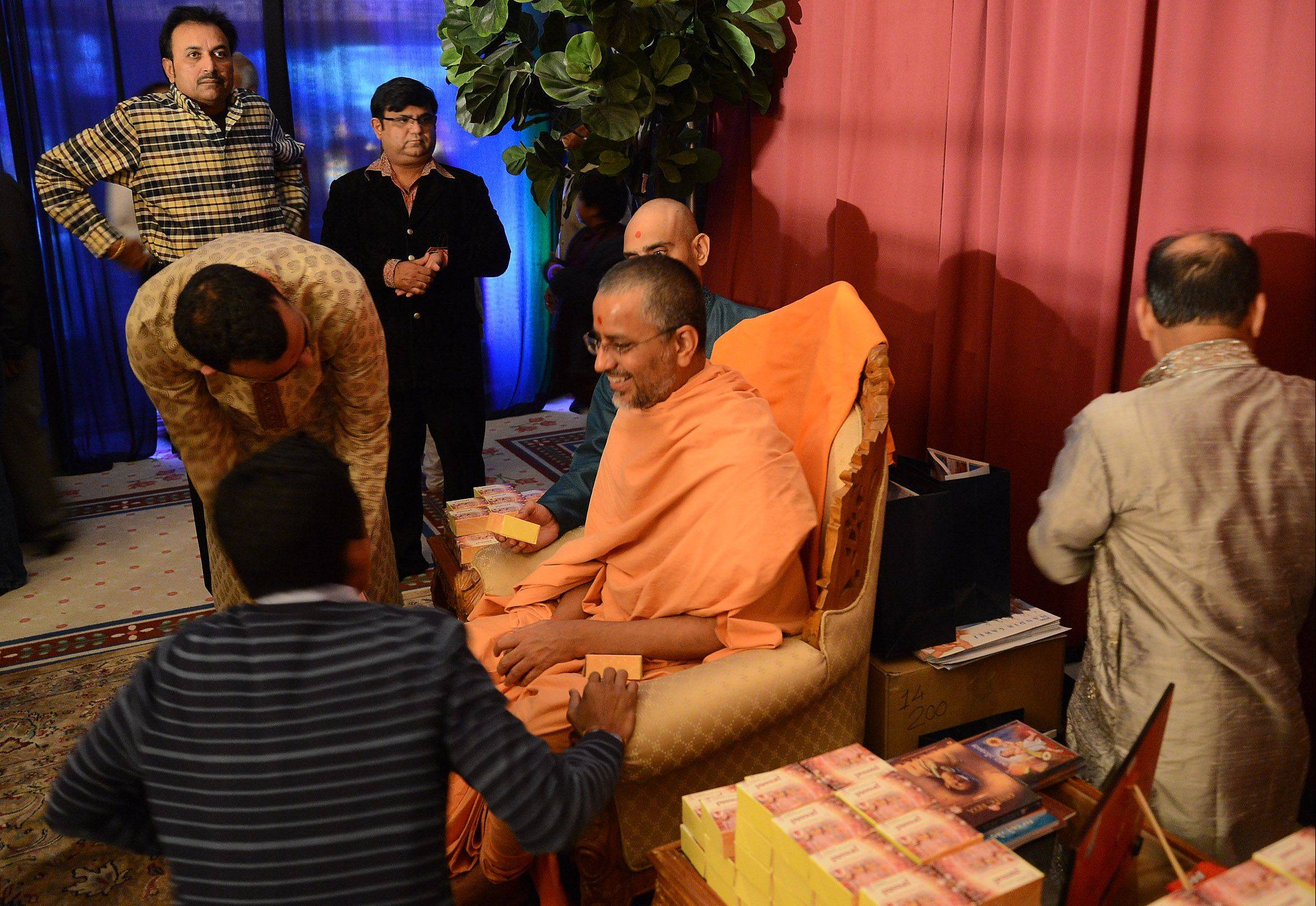 Head priest Sadhu Vivek Murti Das greets guests during the Diwali celebration at BAPS Hindu Mandir in Bartlett.