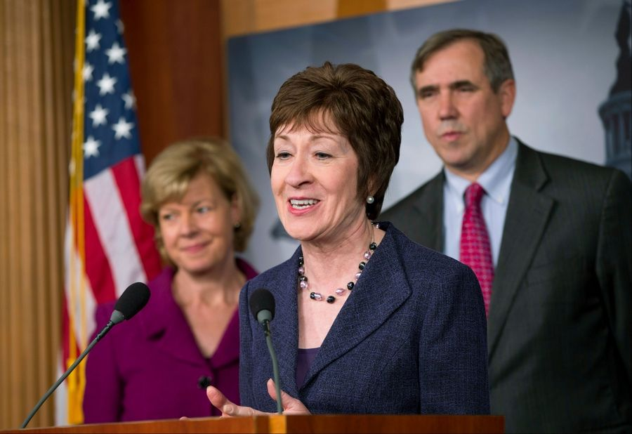 Sen. Susan Collins, a Maine Republican, flanked by Democratic Sens. Tammy Baldwin of Wisconsin, left, and Jeff Merkley of Oregon, talks to reporters Monday after the Senate cleared a major hurdle and agreed to proceed to debate a bill that would prohibit workplace discrimination against gay, bisexual and transgender Americans.