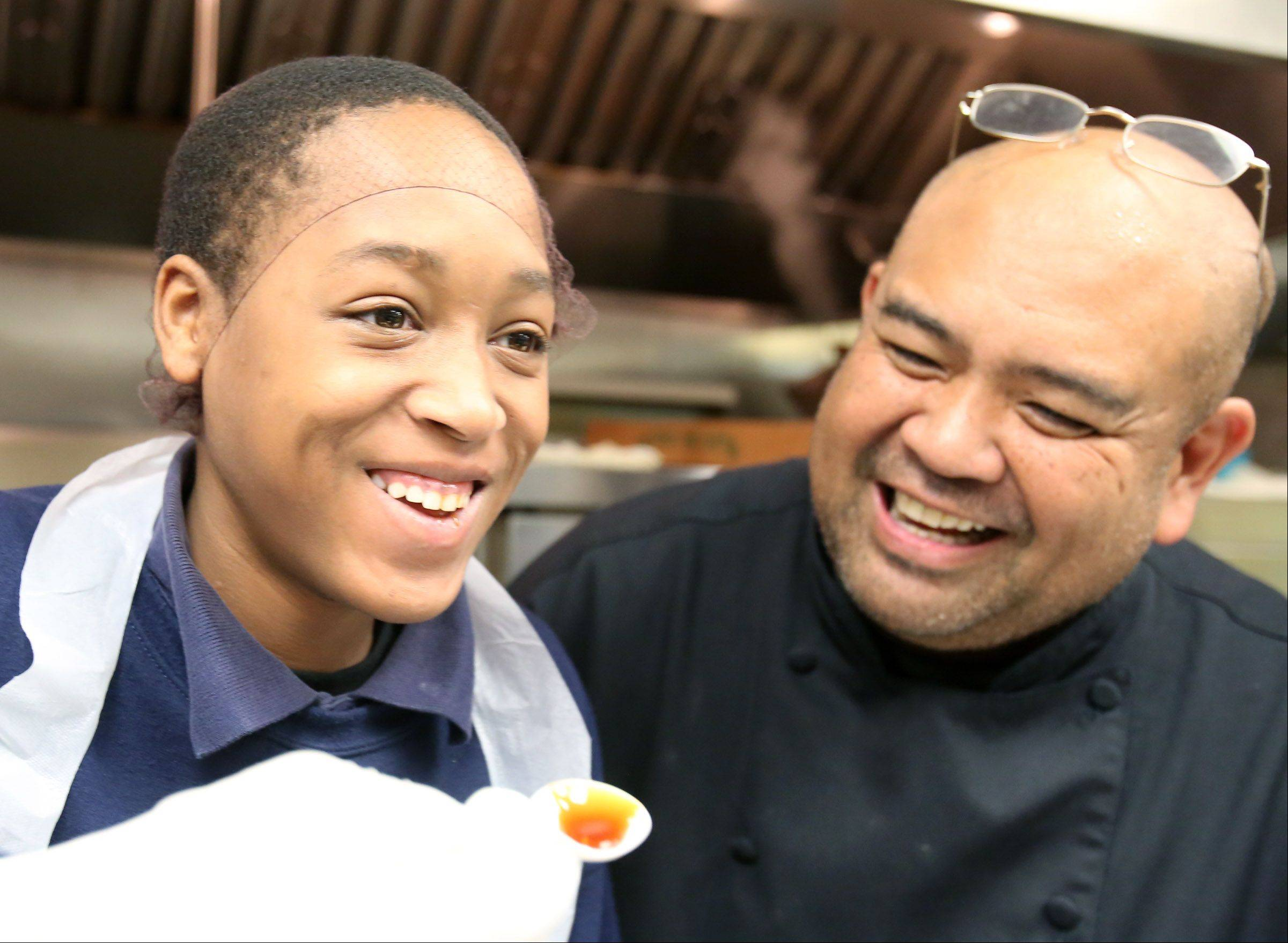Chef Rodelio Aglibot watches student Desmond Balenitinse react to tasting the teriyaki sauce they prepared in the kitchen at Jen School in Des Plaines on Tuesday, October 29.