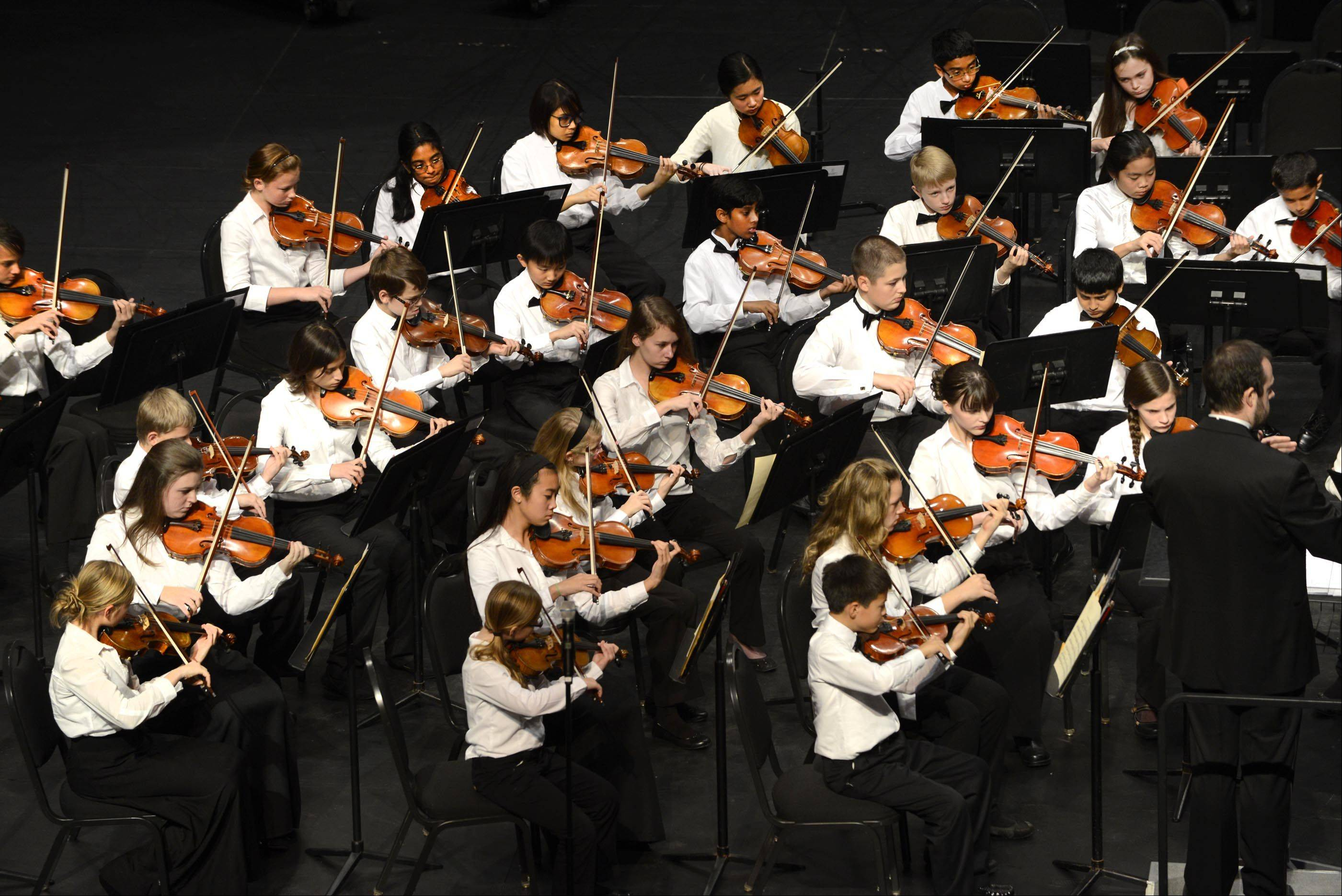 Violins play as the Elgin Youth Symphony Orchestra opens it's 38th concert season Sunday at the Blizzard Theater at Elgin Community College.