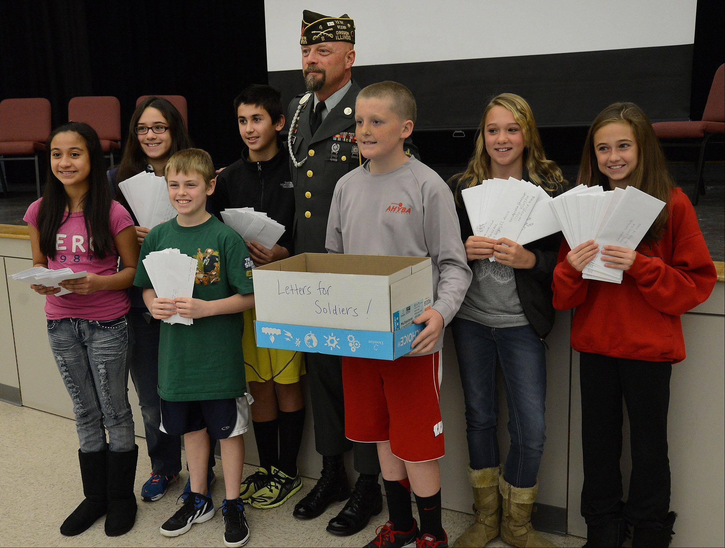 Kirk Catherwood poses with South Middle School sixth-graders who wrote letters for Operation Gratitude to servicemen overseas.