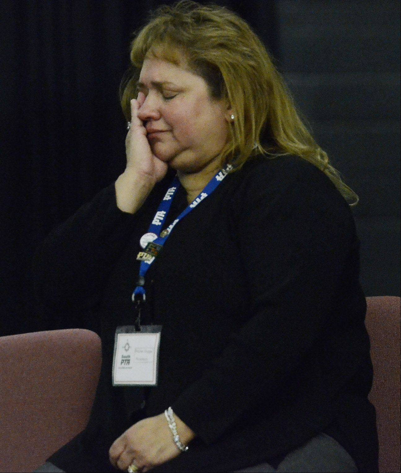 Denise Hoppe, PTA president and family friend, wipes away tears during a moving video featuring Alec Catherwood, who died in Afghanistan.
