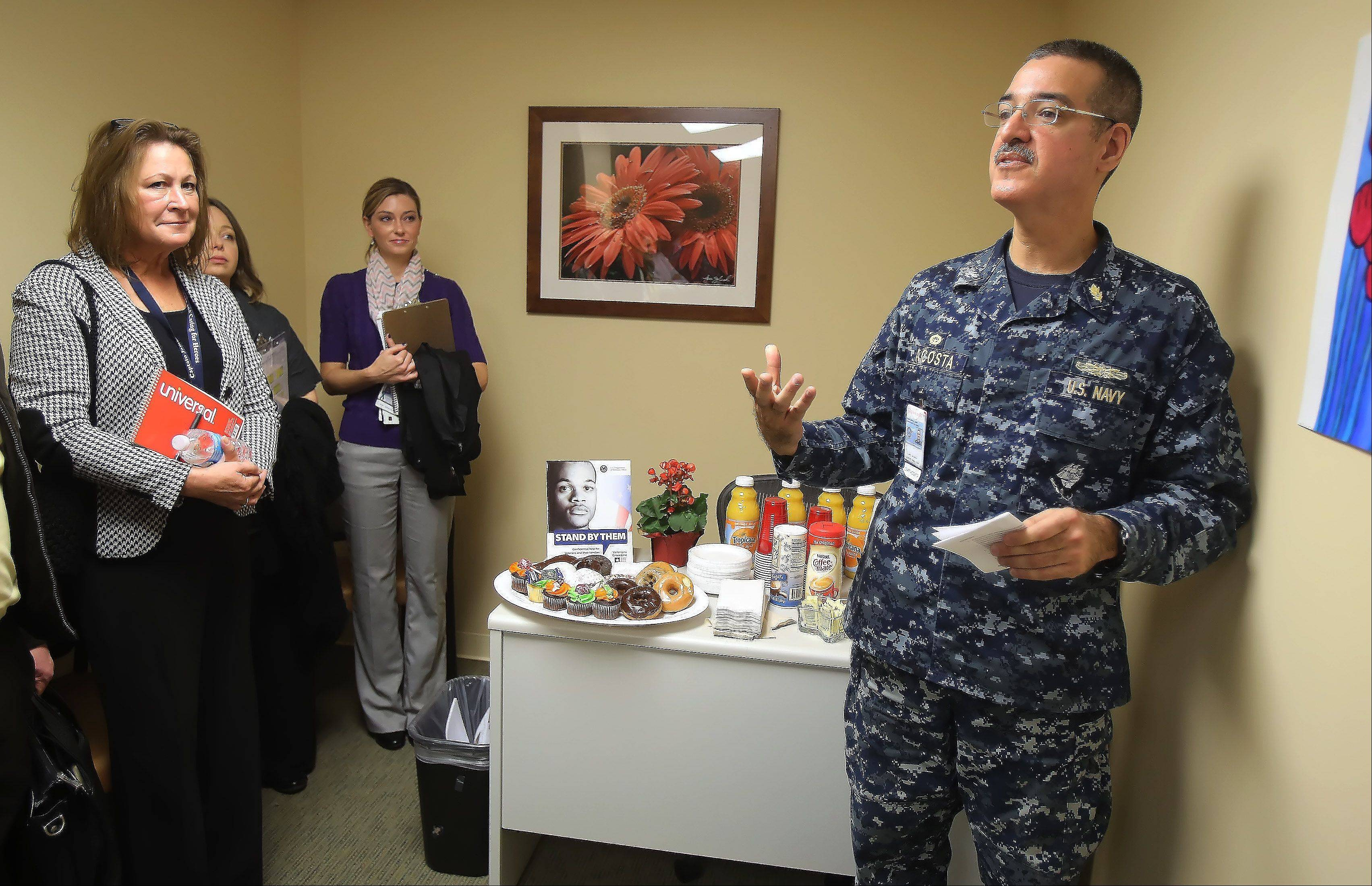 U.S. Navy Capt. Jose Acosta talks about veterans' needs Monday at the Capt. James A. Lovell Federal Health Care Center's new walk-in office for homeless veterans. Acosta is the Lovell Center's deputy director.