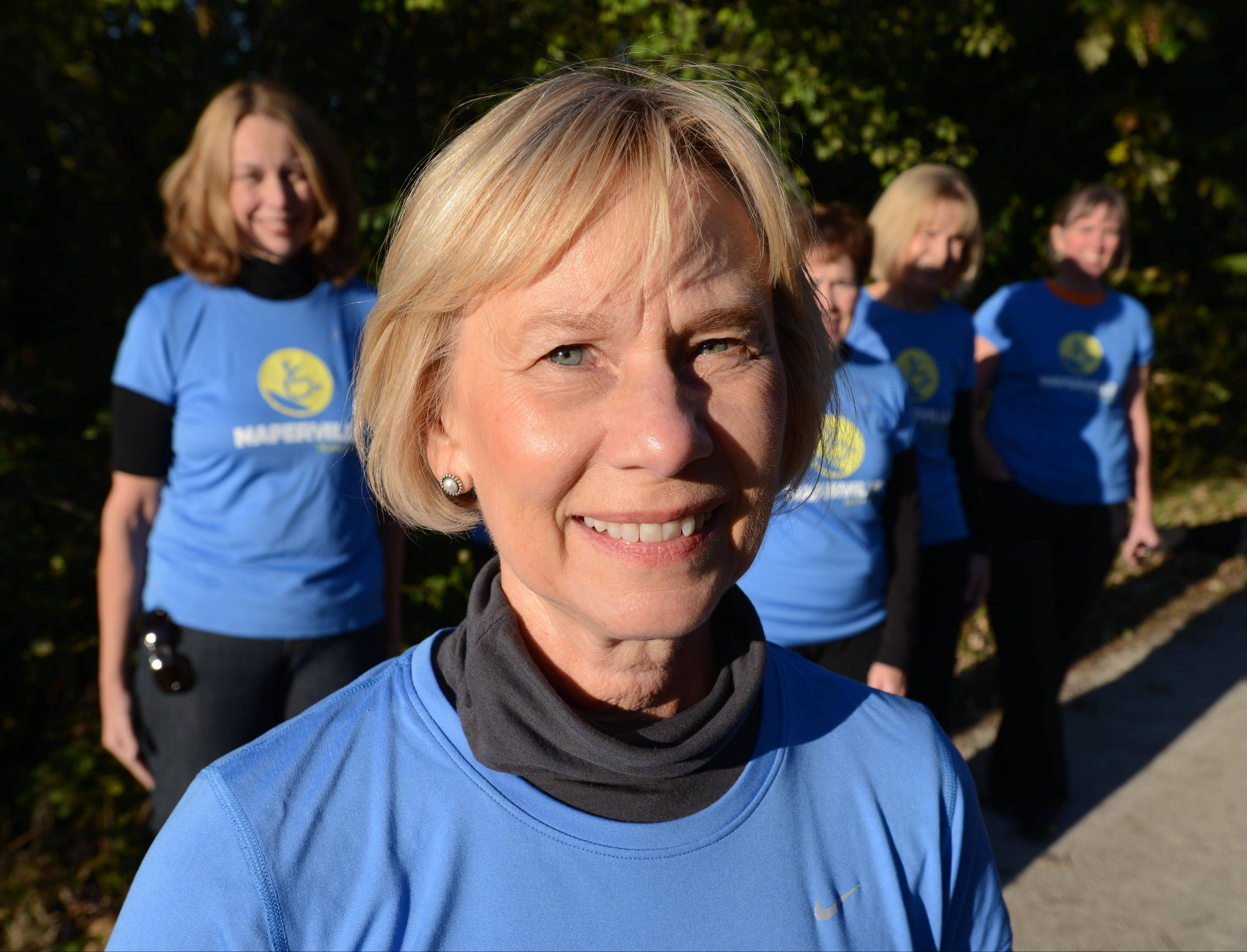 Ginni Kent of Glen Ellyn and her teammates are running the Naperville Half Marathon to support Spinal Cord Injury Sucks, a charity her son, Geoff, started.
