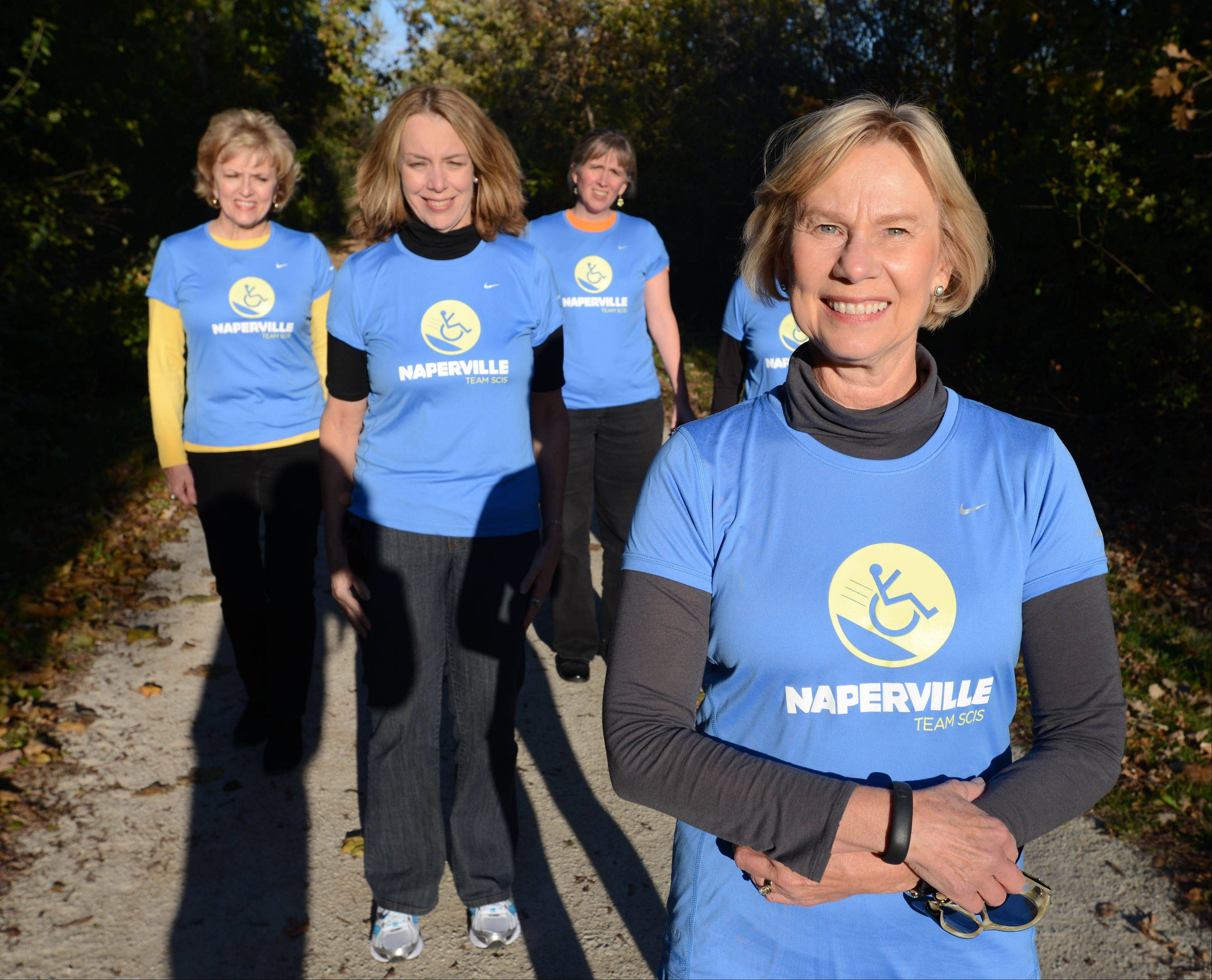 Ginni Kent of Glen Ellyn gathered a team of friends to compete as charity runners in the inaugural Edward Hospital Naperville Half Marathon on Sunday, Nov. 10, raising money for Spinal Cord Injury Sucks.