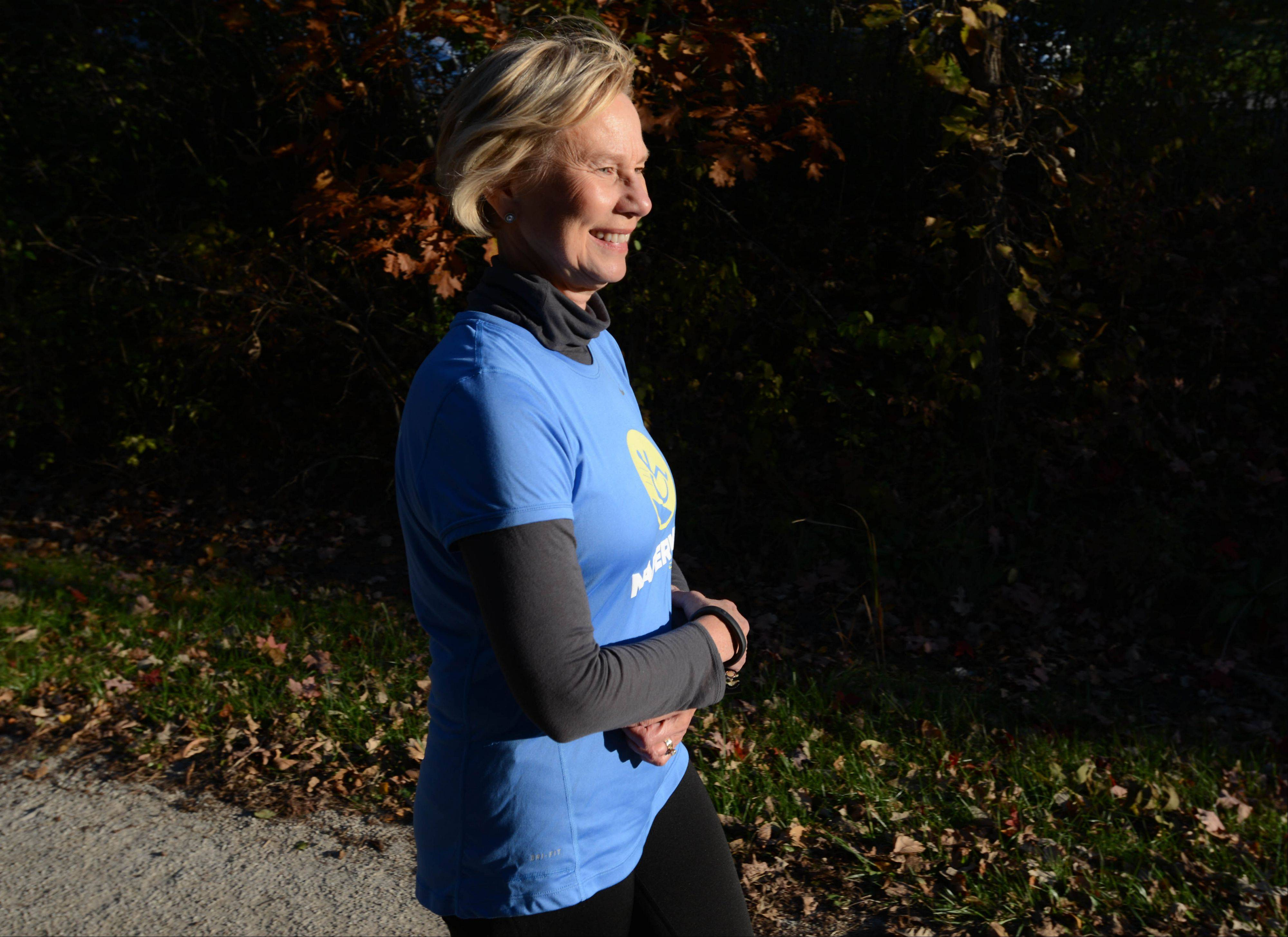 Ginni Kent of Glen Ellyn trains for her first half marathon along the Illinois Prairie Path in Wheaton. She is running to support Spinal Cord Injury Sucks, which her son, Geoff, started after being paralyzed from the chest down in a 2007 downhill skiing accident.