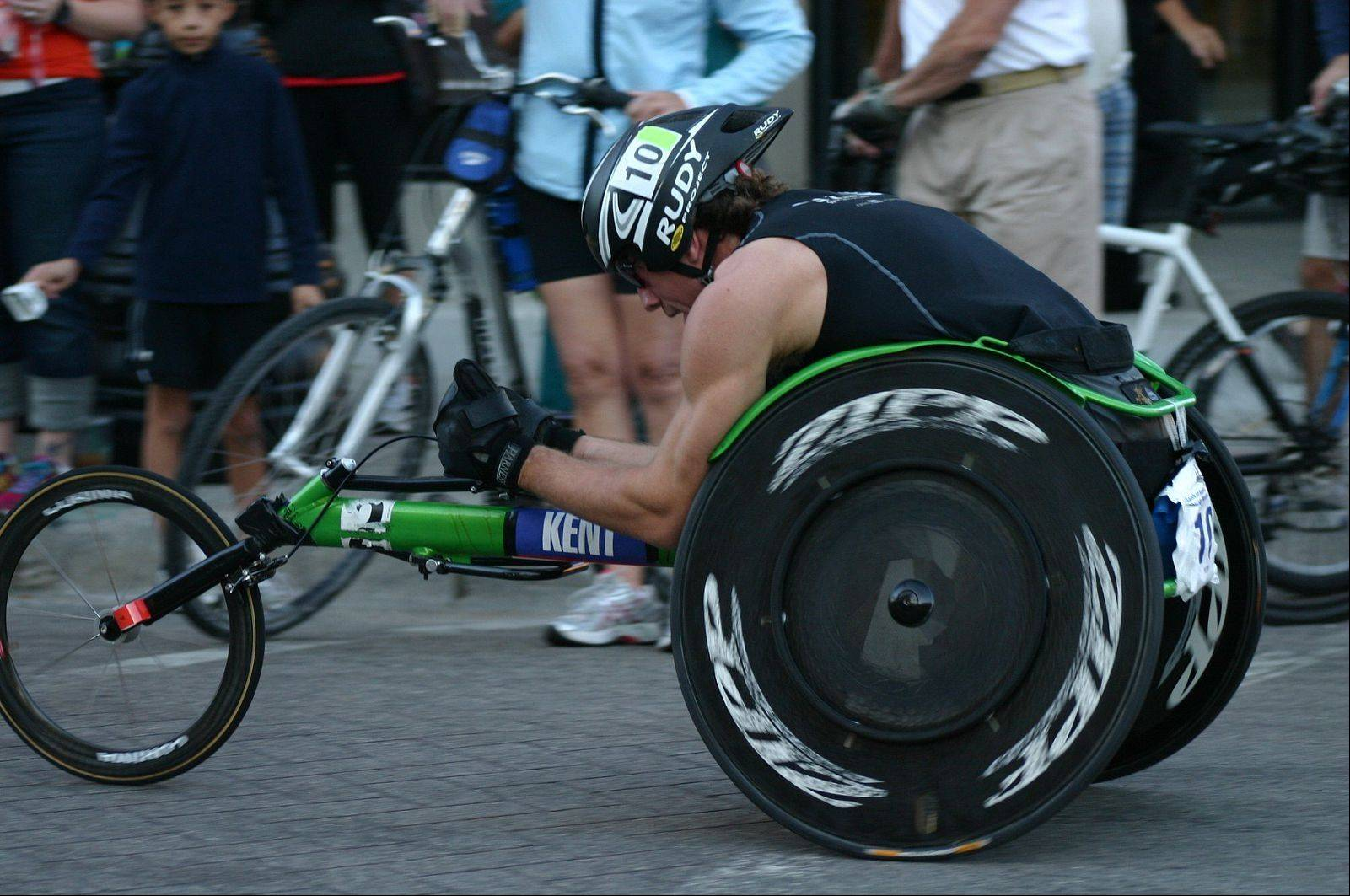 Geoff Kent, 34, races in a previous Chicago Marathon to raise funds for Spinal Cord Injury Sucks, which he started after being paralyzed from the chest down in a 2007 downhill skiing accident.