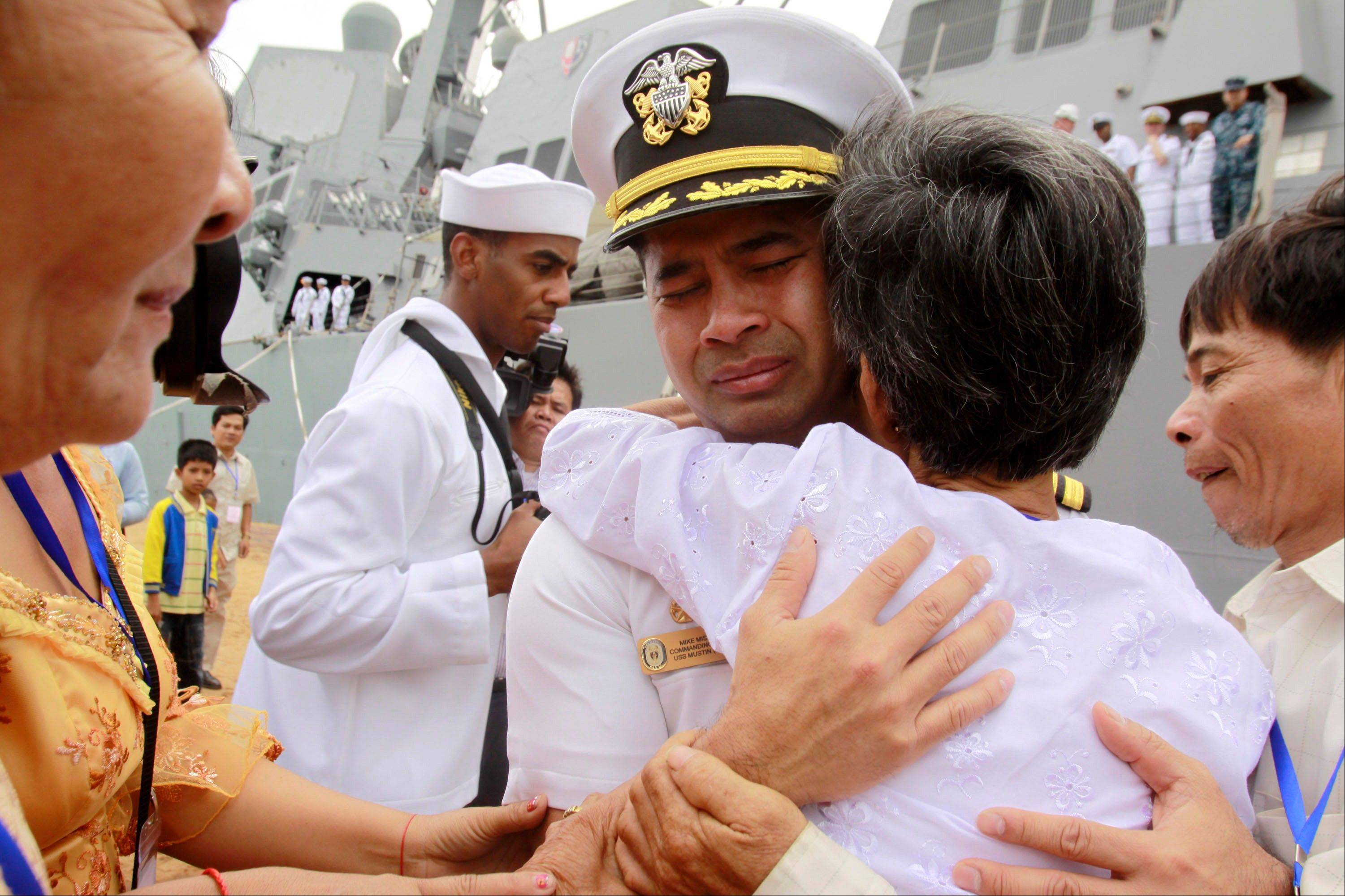 "U.S. navy officer Michael ""Vannak Khem"" Misiewicz becomes emotional as he embraces his aunt Samrith Sokha, 72, at Cambodian coastal international see port of Sihanoukville, Cambodia in 2010. Misiewicz passed confidential information on ship routes to Malaysian businessman Leonard Francis' Singapore-based company, Glenn Defense Marine Asia Ltd., or GDMA, according to the court documents."