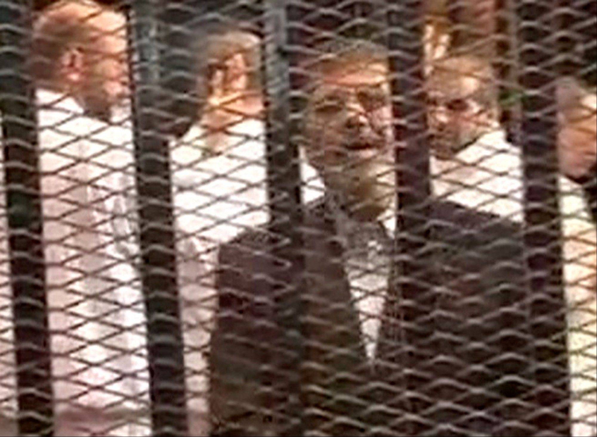 This image made from video provided by Egypt's Interior Ministry shows ousted President Mohammed Morsi speaking from the defendant's cage as he stands with co-defendants in a makeshift courtroom during a trial hearing in Cairo, Egypt, Monday.