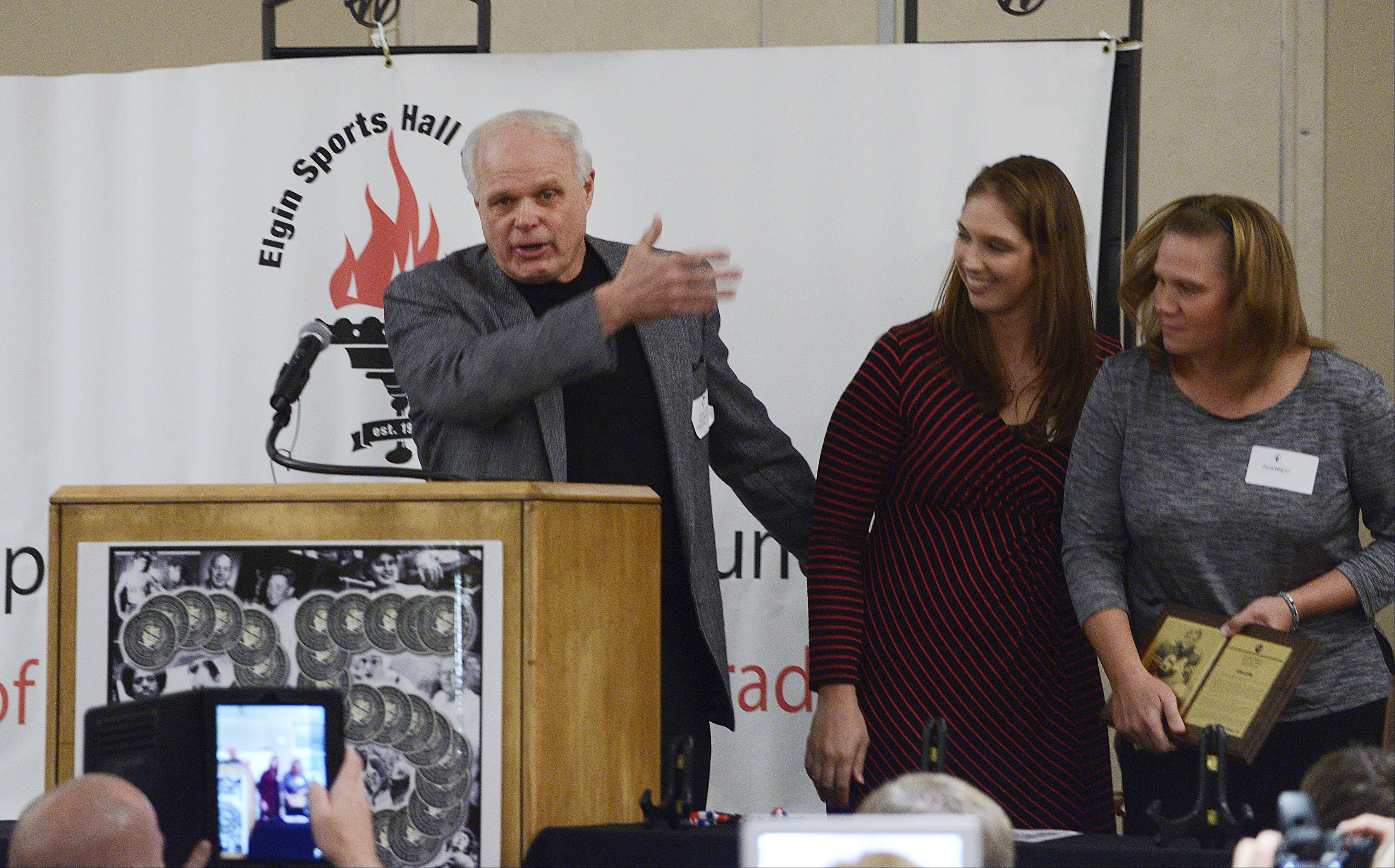 Larkin graduate Alan Lettow acknowledges his daughters, Dana and Stacy, who introduced him during the 34th Induction Ceremony of the Elgin Sports Hall of Fame Foundation Sunday at The Centre of Elgin.