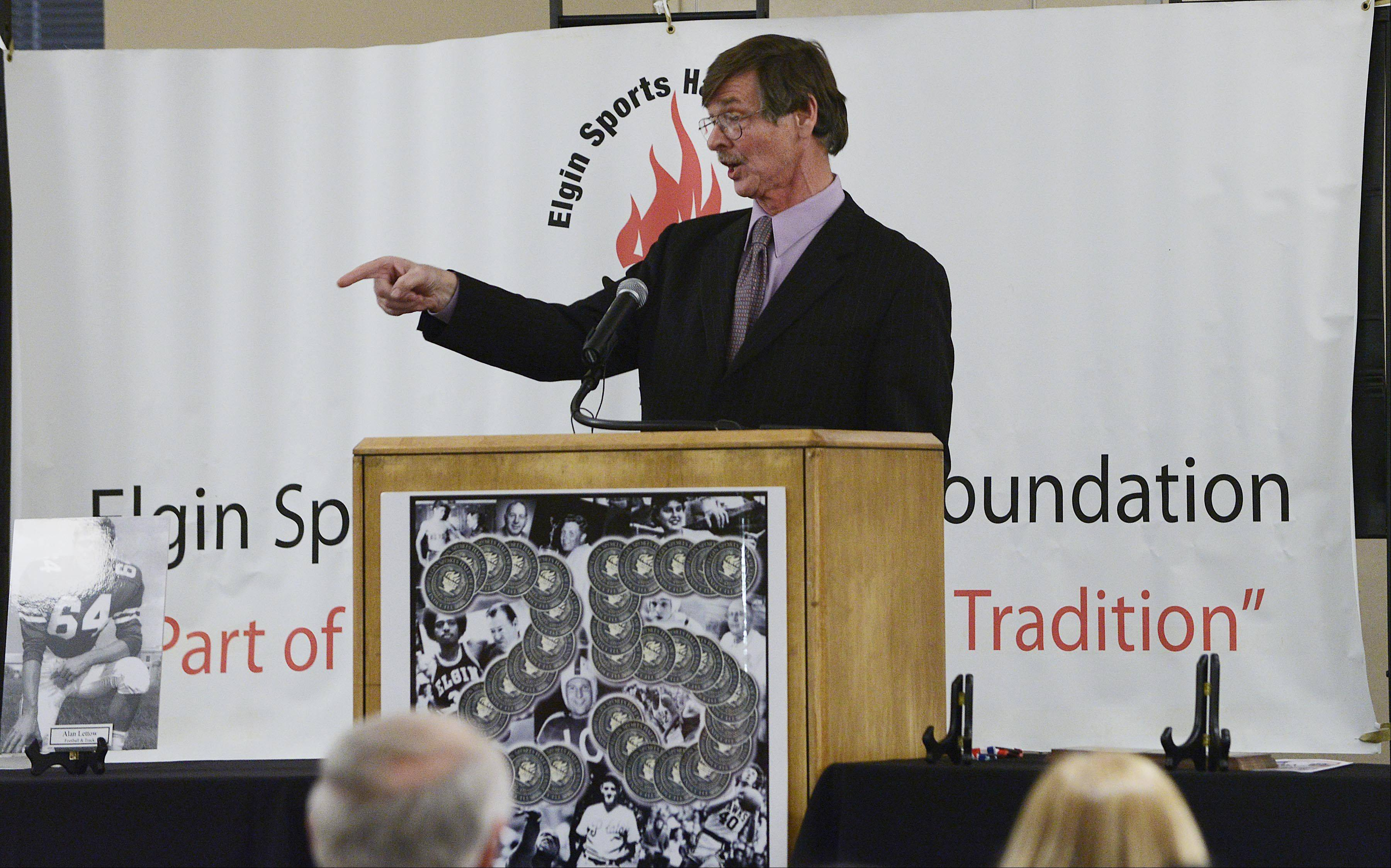 Jeff Myers tells stories of games he called as a sportscaster as he accepts his plaque during the 34th Induction Ceremony of the Elgin Sports Hall of Fame Foundation Sunday at The Centre of Elgin.