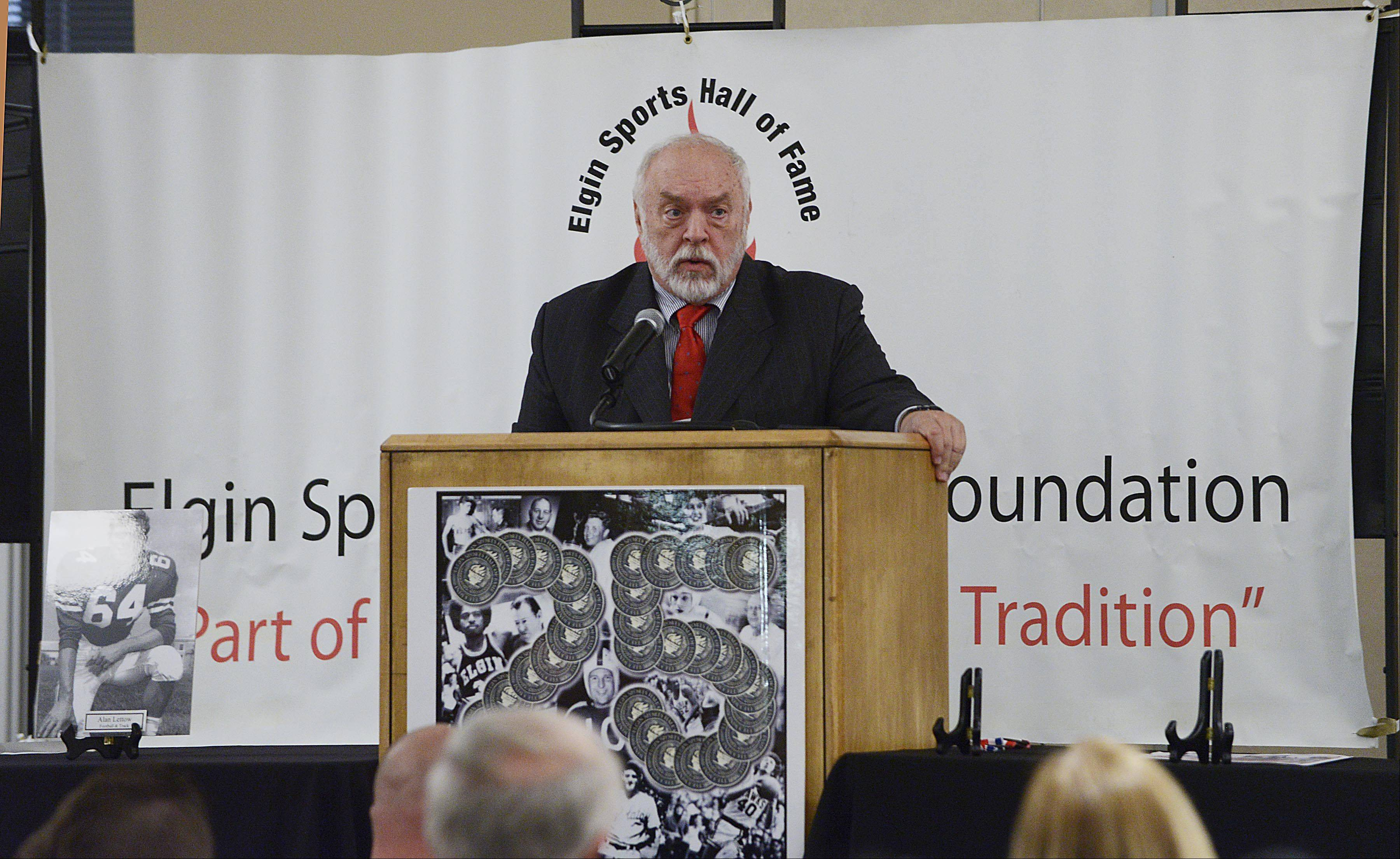 Dave Russell speaks as he accepts his plaque during the 34th Induction Ceremony of the Elgin Sports Hall of Fame Sunday at The Centre of Elgin.