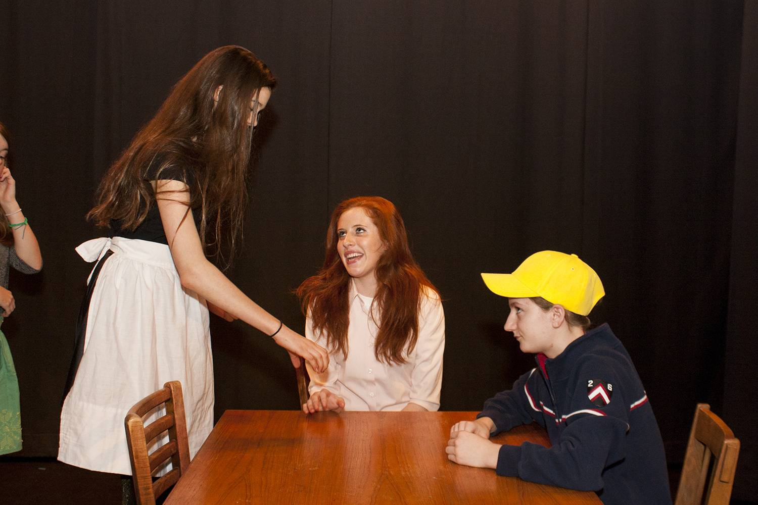 "Woodlands Academy of the Sacred Heart students (from left) Eleanore van Marwijk of Lake Barrington, Grace Reyes of Kenilworth and Elizabeth Bartusiak of Lake Forest rehearse  a scene from ""Our Town""  to be presented by the Lake Forest school's Theatre Program Nov. 7-10."