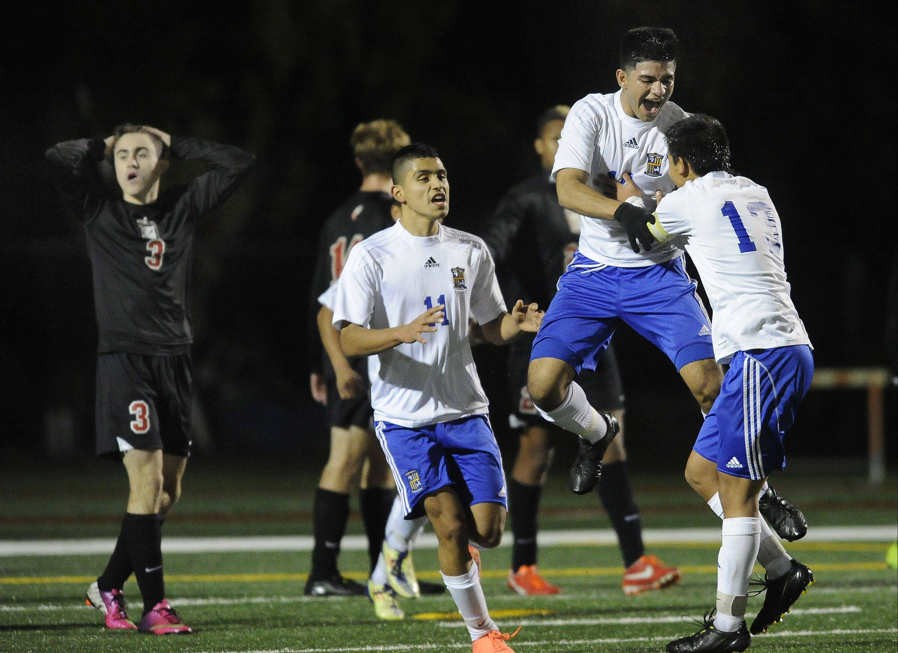 Wheeling�s Marino Lopez and teammate Jose Garcia celebrate Lopez�s go-ahead goal during the Wildcats� 2-1 victory over Barrington in Class 3A supersectional play at Hersey on Tuesday.