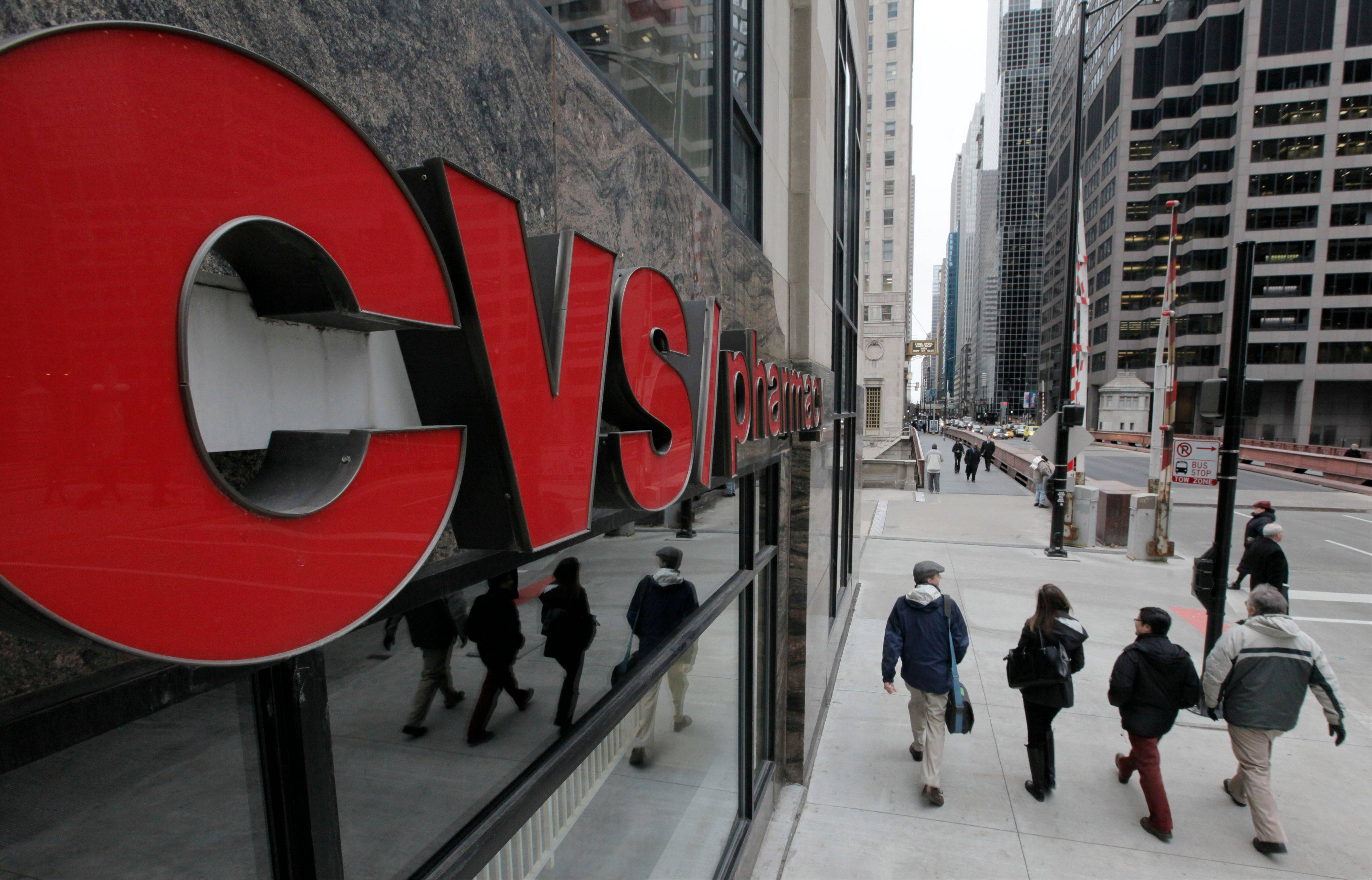 CVS Caremark says its third-quarter net income climbed 25 percent in performance that beat Wall Street expectations.