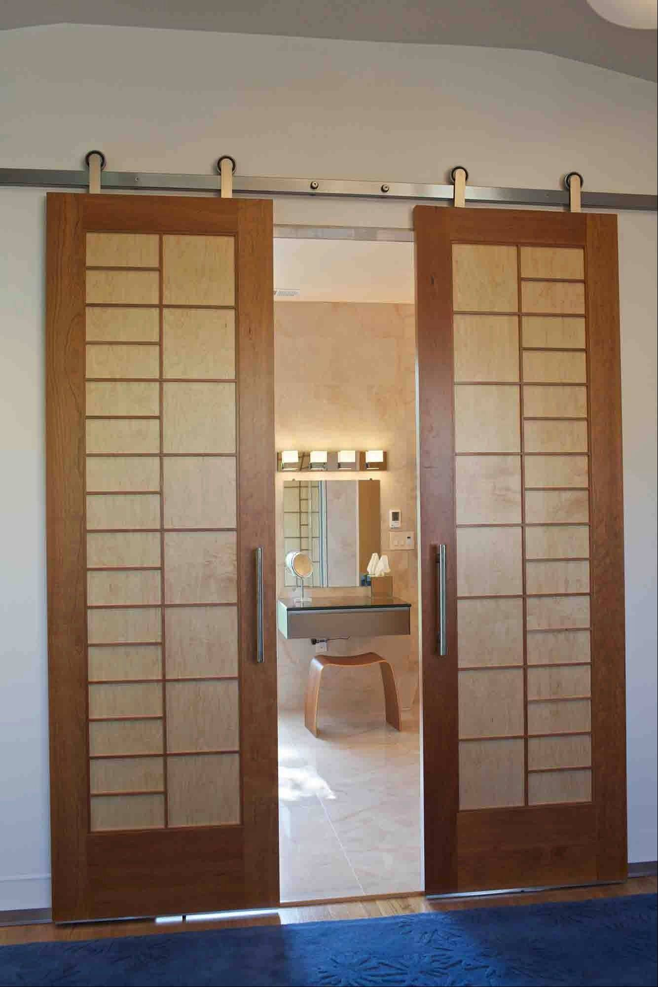 A pair of 8-foot tall doors serve as the entrance to the master bathroom. They slide open on barn door hardware purchased online through Krown Lab, a small company in Oregon. The doors were purchased online and custom made through Cherry Tree Design in Bozeman.
