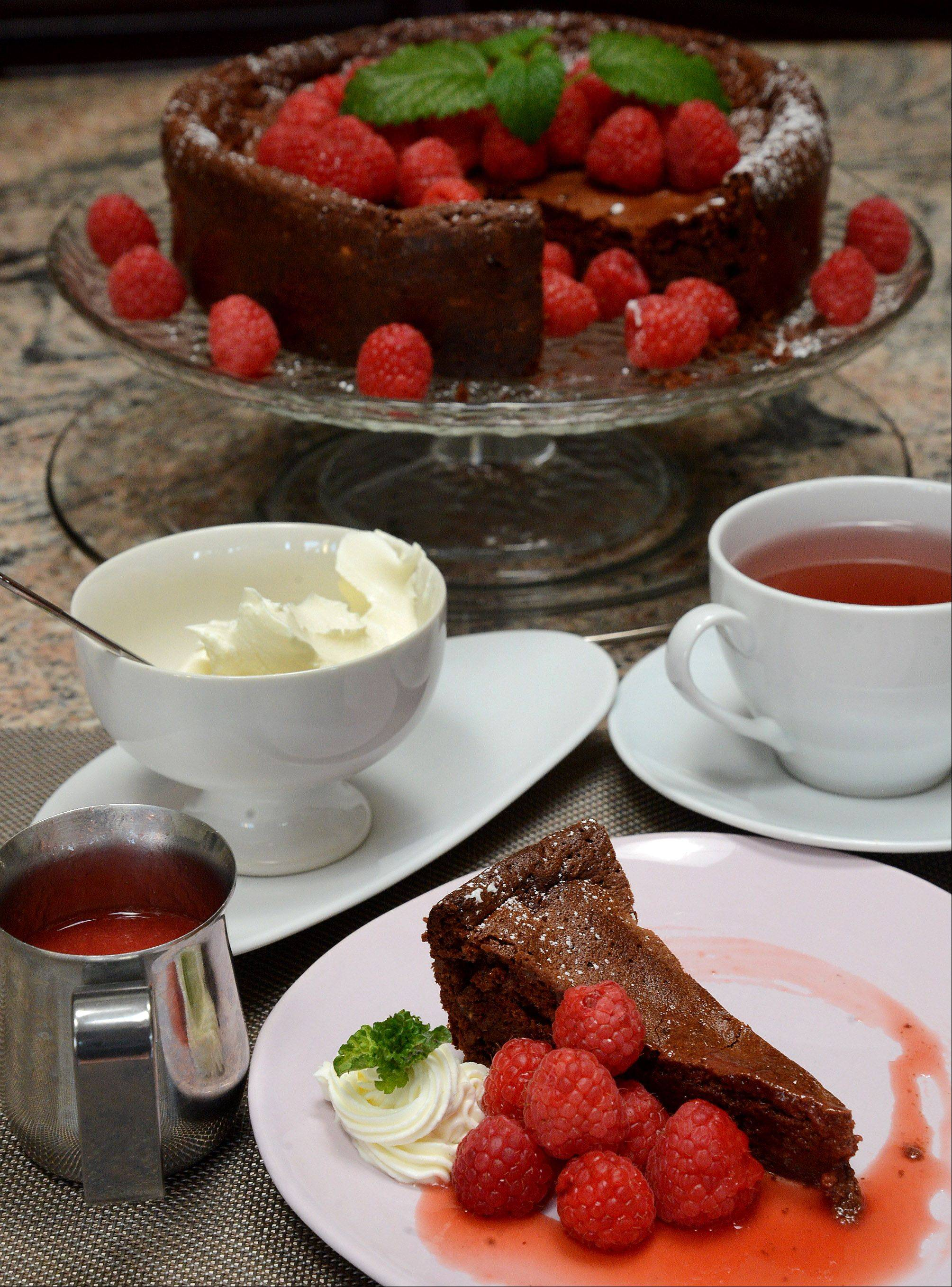 Fresh raspberry coulis accents a rich yet airy chocolate cake.