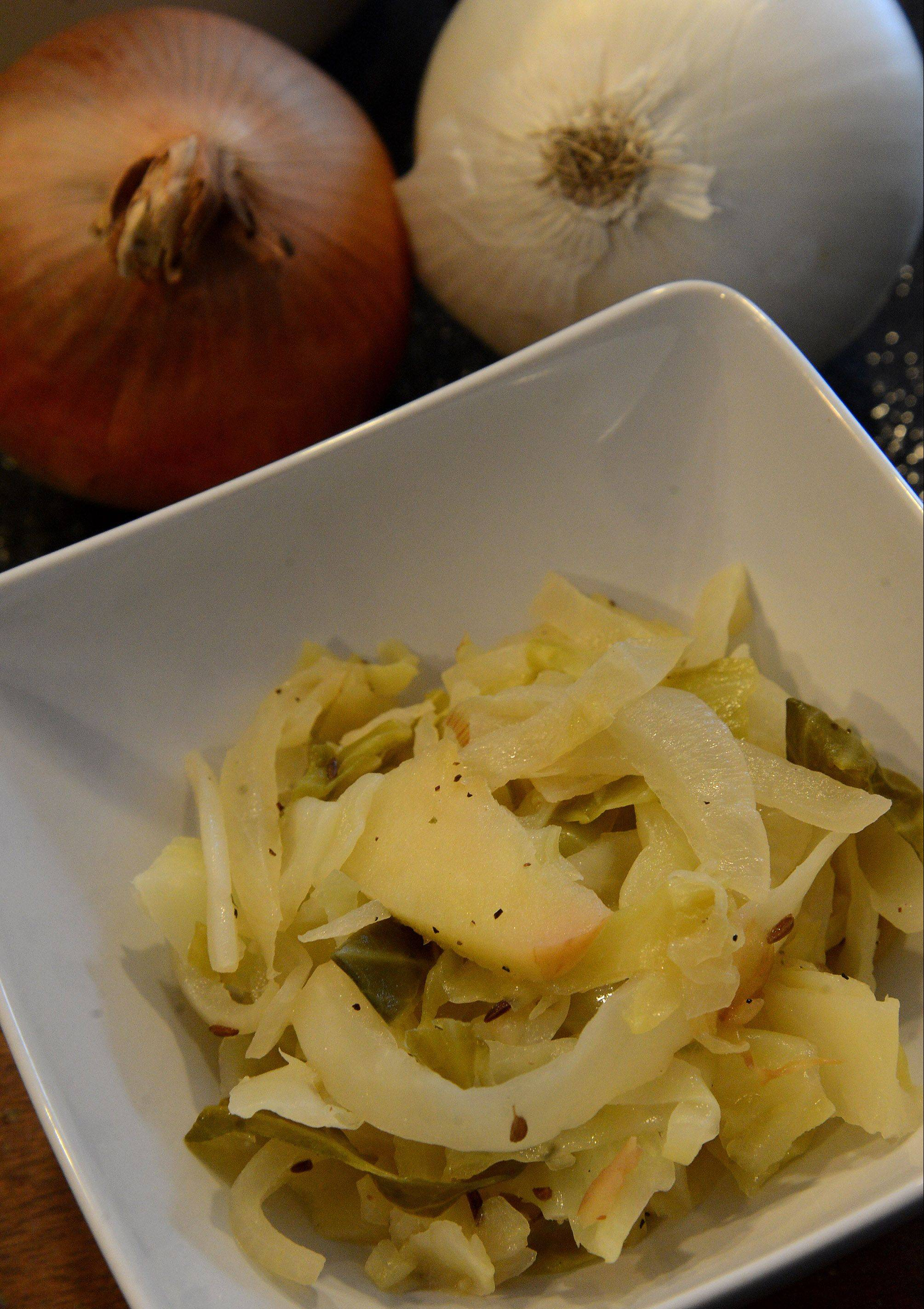 Enjoy onion's healthful attributes in an autumnal dish of sauteed cabbage, onions and apples.