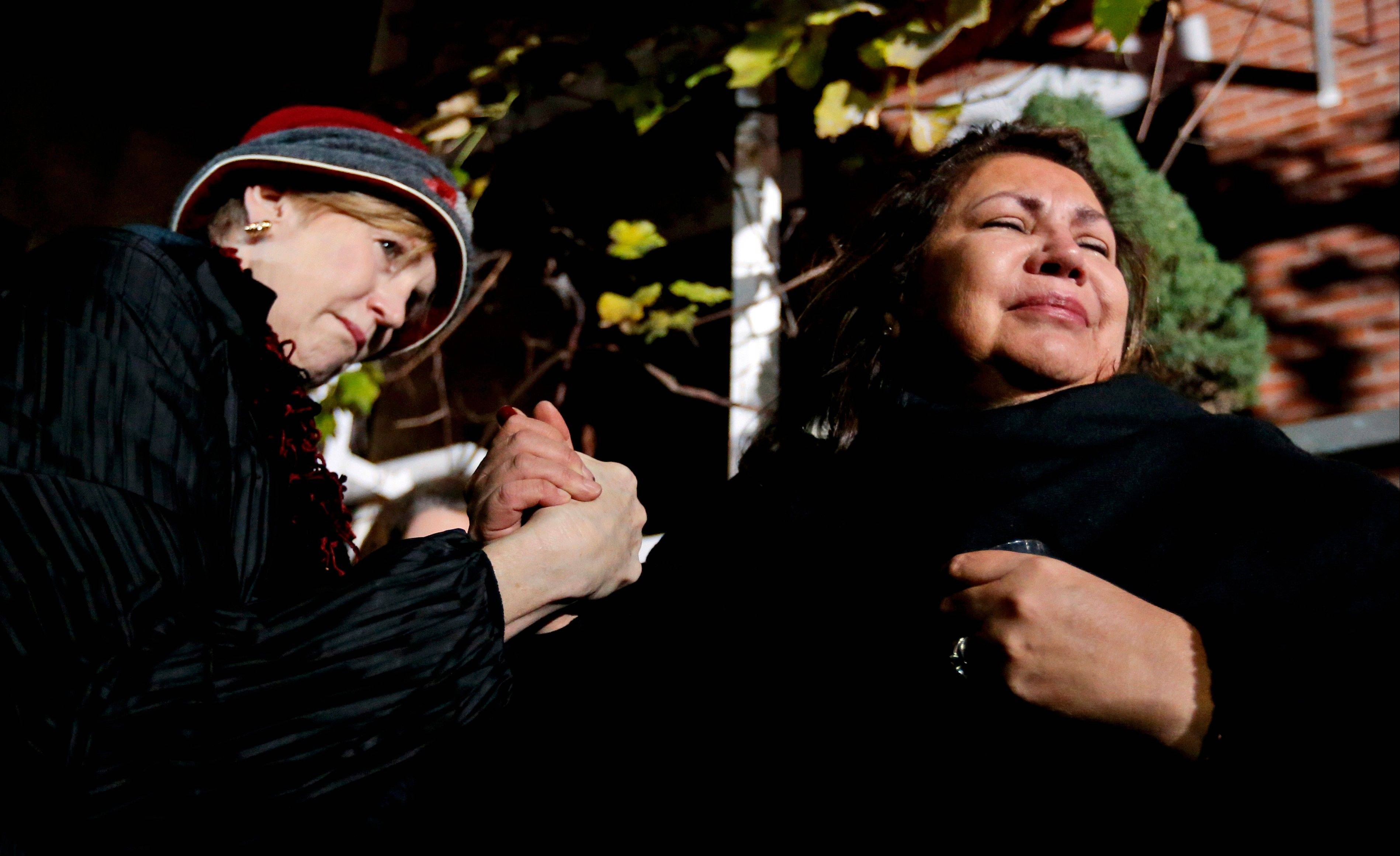 Margaret O'Connor, left, consoles chef Priscila Satkoff during a candlelight memorial Tuesday for chef Charlie Trotter outside Trotter's former restaurant.