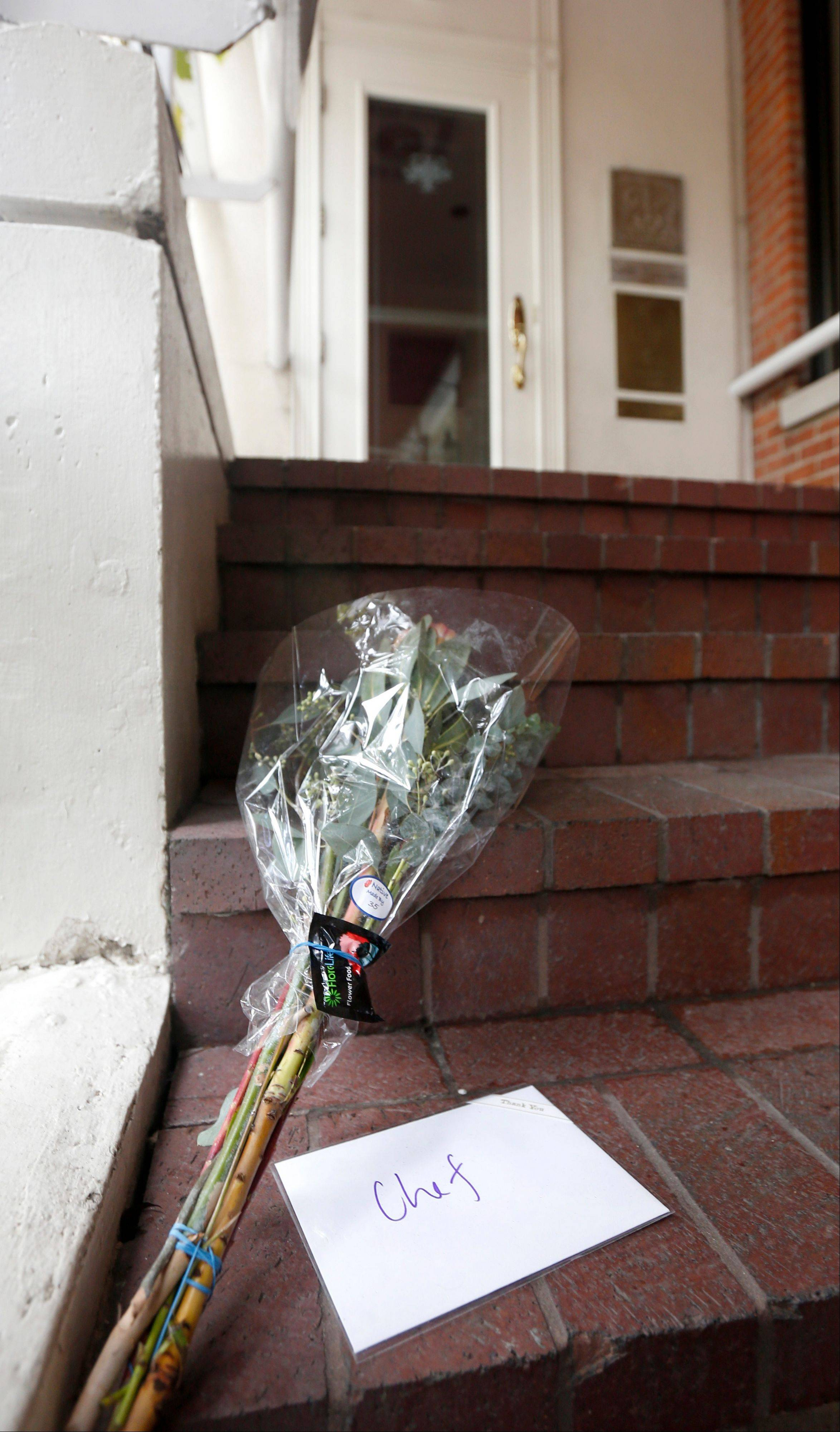 A card addressed to Chef, and a bouquet of flowers rest on the stairs to Charlie Trotter's permanently closed Chicago restaurant after reports of the chef's death Tuesday, Nov. 5, 2013, in Chicago. Trotter, 54, an award-winning chef, was a self-taught culinary master whose eponymous Chicago restaurant elevated the city�s cuisine and provided a training ground for some of the nation�s other best chefs.