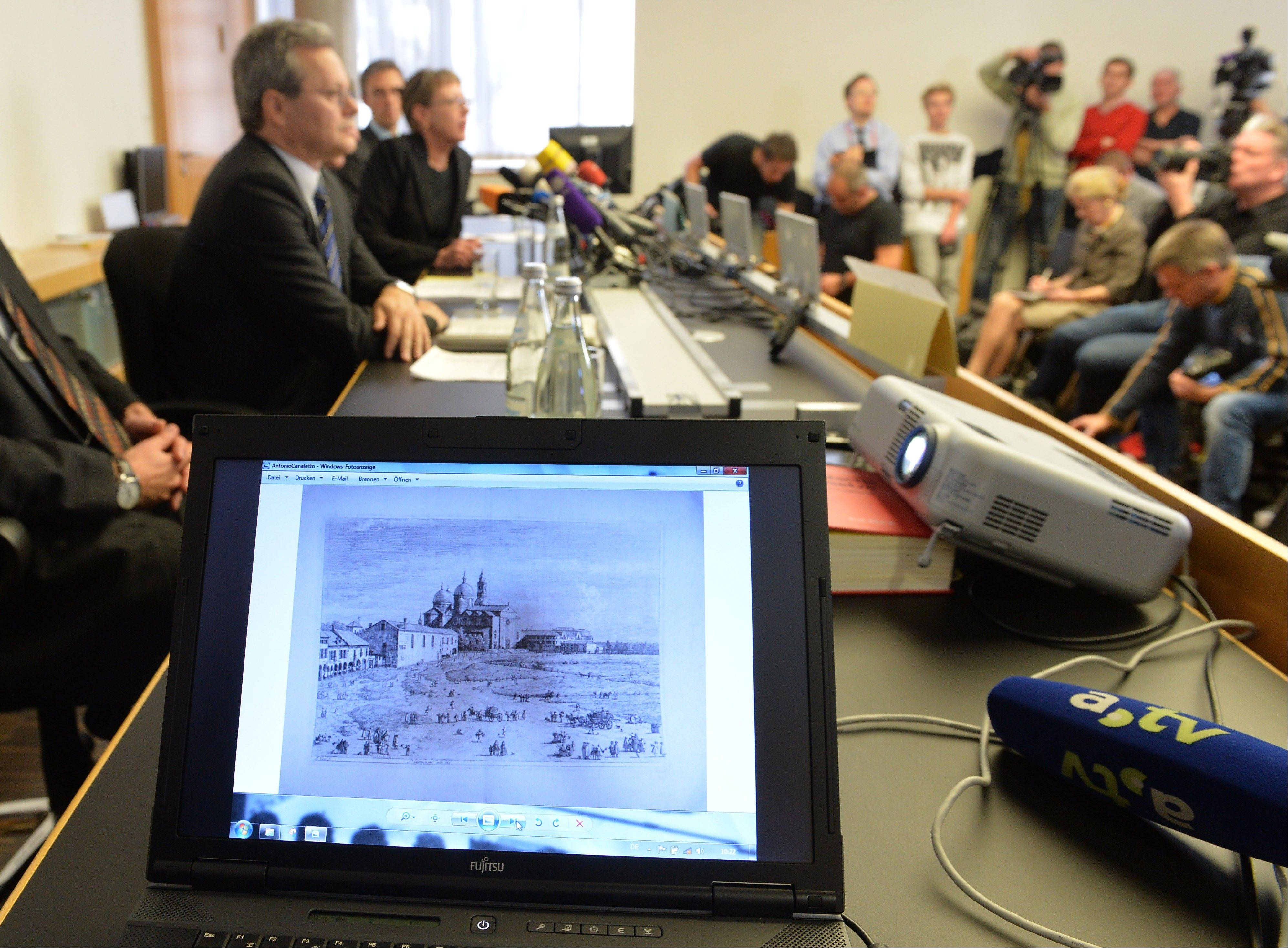 An artwork of Antonio Canaletto is shown on a computer screen during a news conference in Augsburg, southern Germany, Tuesday, Nov. 5, 2013, on the art found in Munich. A hoard of more than 1,400 art works found last year at a Munich apartment includes previously unknown pieces by artists including Marc Chagall, German investigators said Tuesday, adding that they face a hugely complicated task to establish where the art came from.
