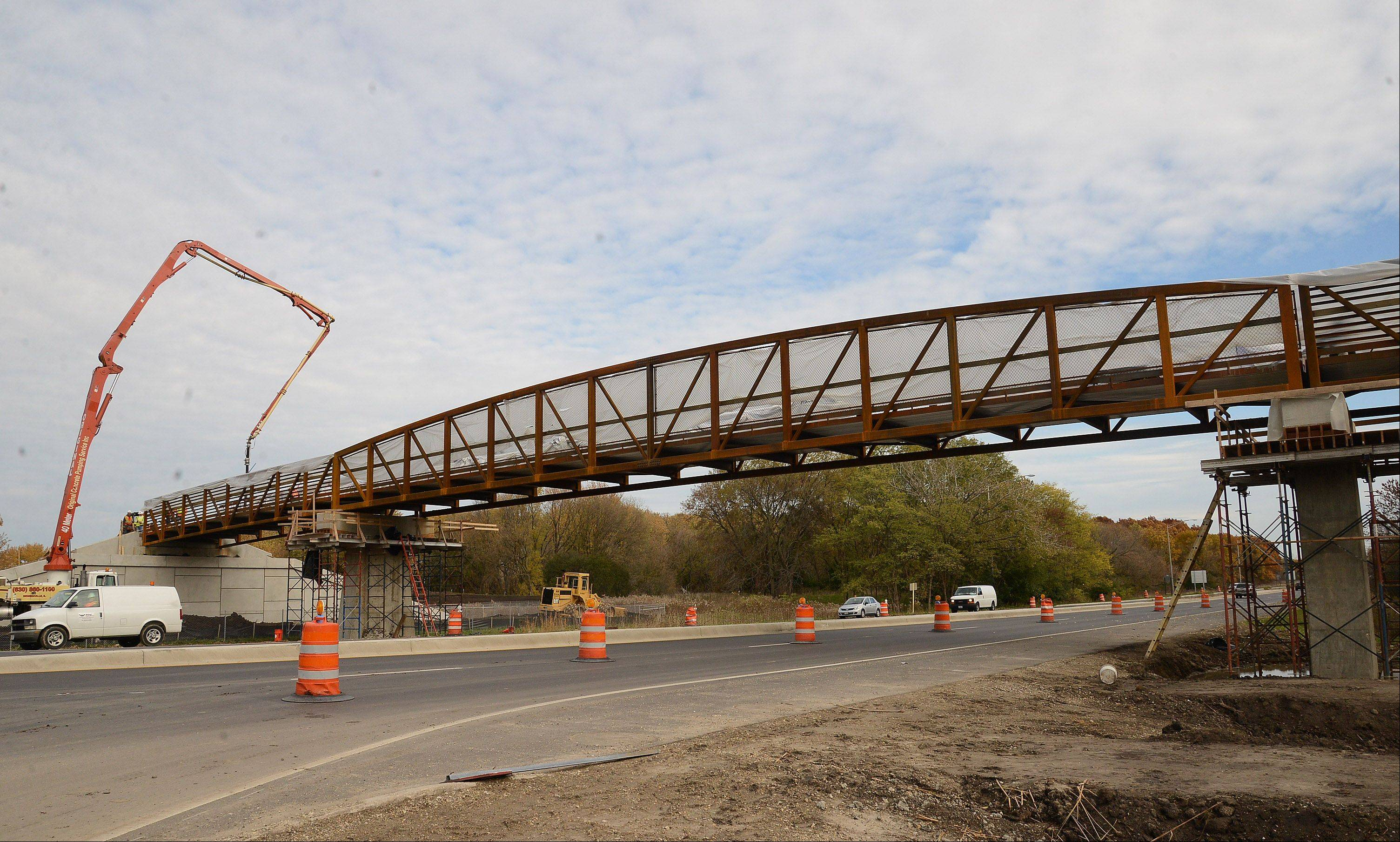 Construction of a long-awaited bridge crossing Higgins Road at Busse Woods is progressing faster than expected and could be complete by the end of the year. Officials say the bridge will provide a safe crossing point for bicyclists and pedestrians.