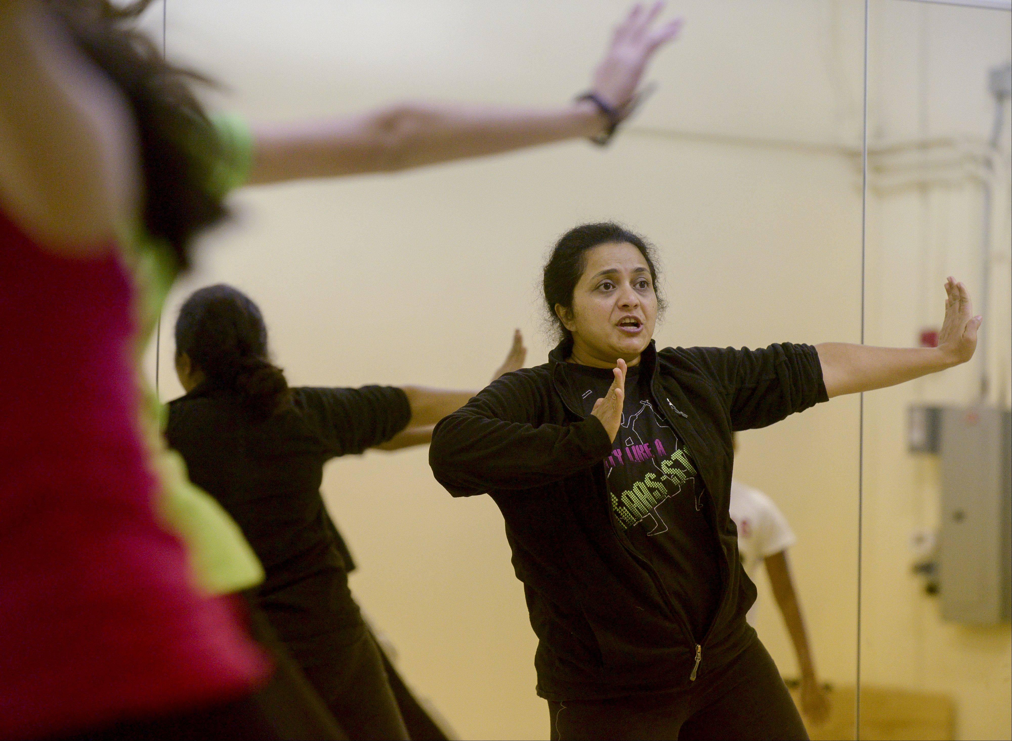 Dance instructor Bhagya Nagesh leads students at Bollywood Rhythms in Naperville as they practice to perform Sunday along the route of the Inaugural Edward Hospital Naperville Marathon and Half Marathon.