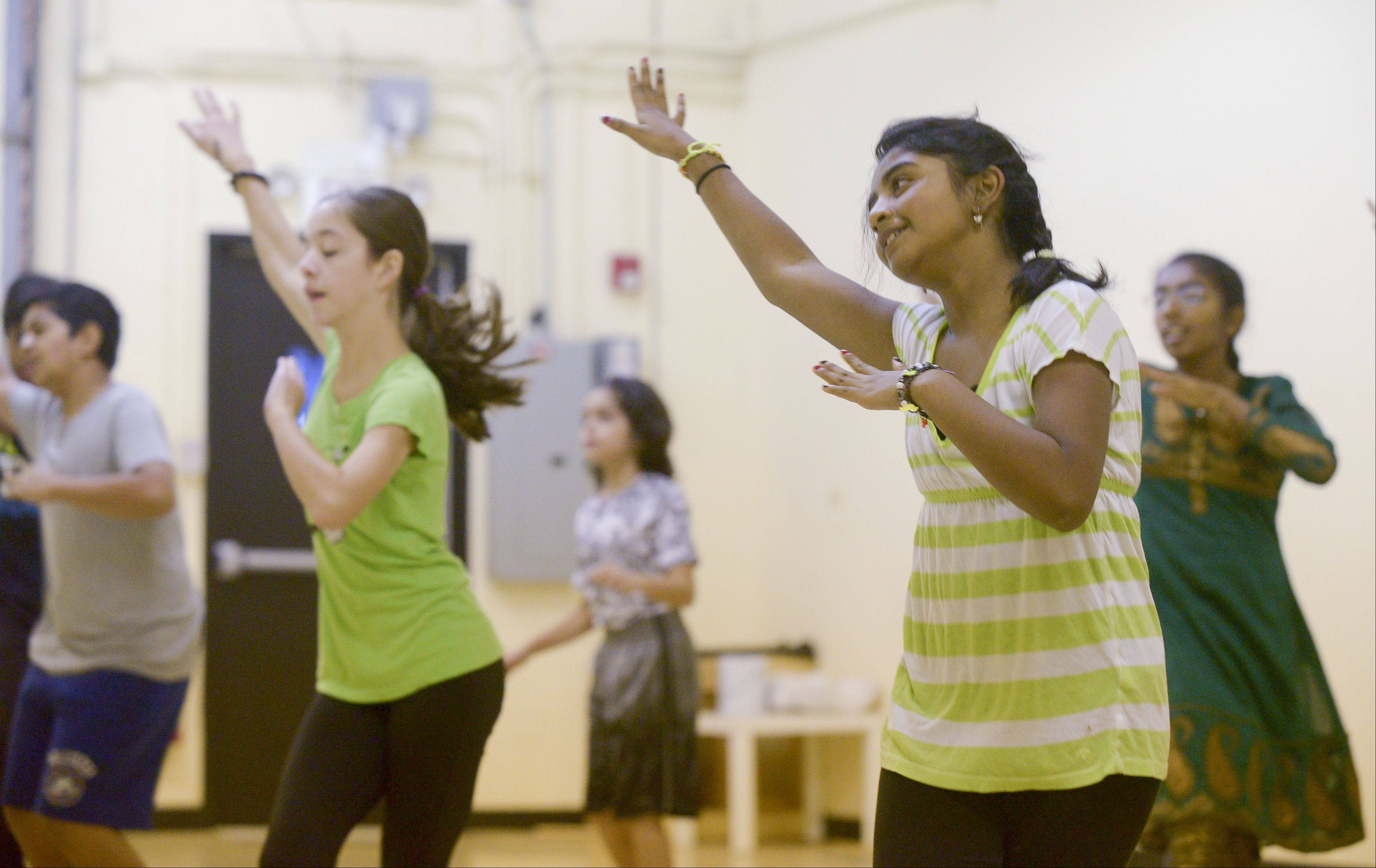 Bollywood Rhythms students such as 12-year-old Shreya Magesh of Oswego, right, will perform Sunday along the course of the Inaugural Edward Hospital Naperville Marathon and Half Marathon.