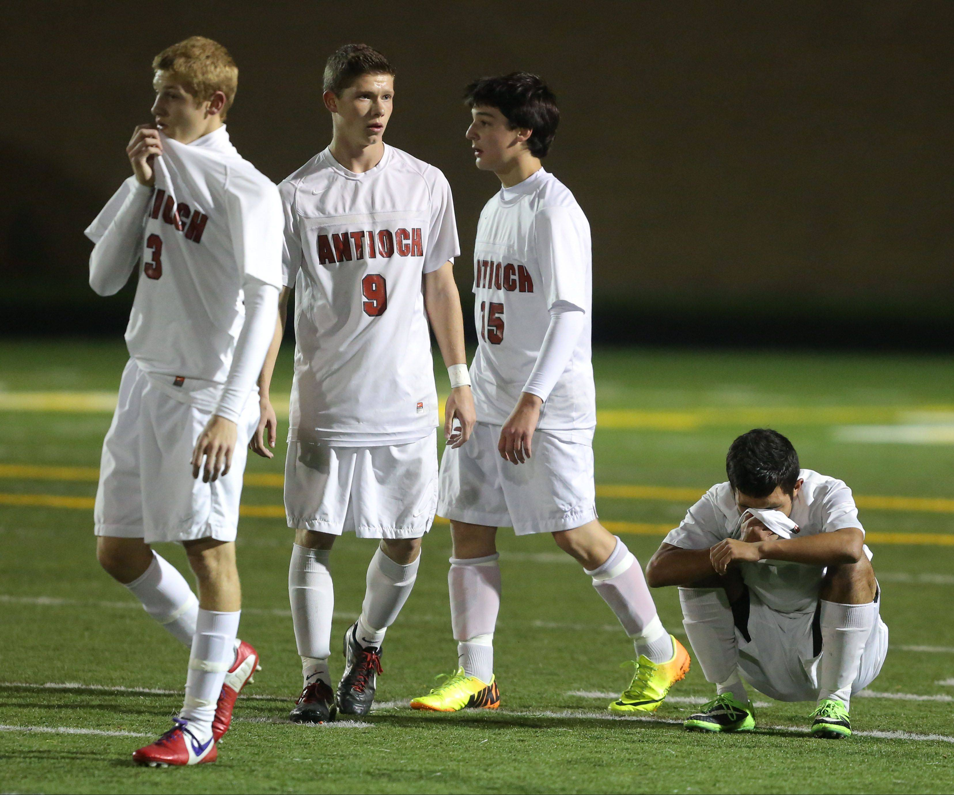 From left, Antioch's Danny Brito, Krystian Streit, Danny Lonski and Iven Hernandez come to grips with a 1-0 loss to St. Ignatius in Class 2A supersectional play Tuesday night at Stevenson.