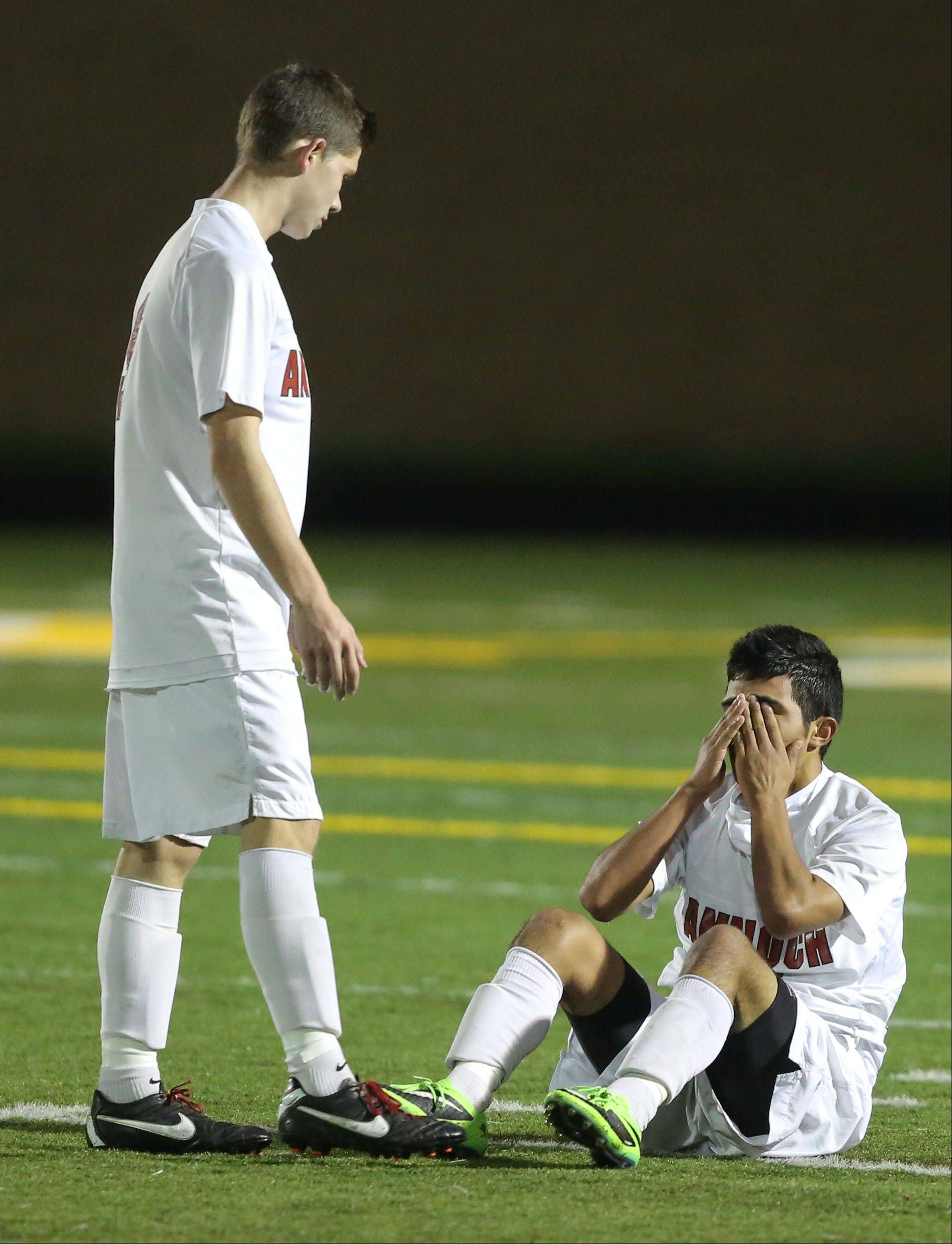 Steve Lundy/slundy@dailyherald.comAntioch's Krystian Streit, left, goes to console Iven Hernandez after the Sequoits fell to St. Ignatius 1-0 in the Class 2A supersectional Tuesday night at Stevenson.