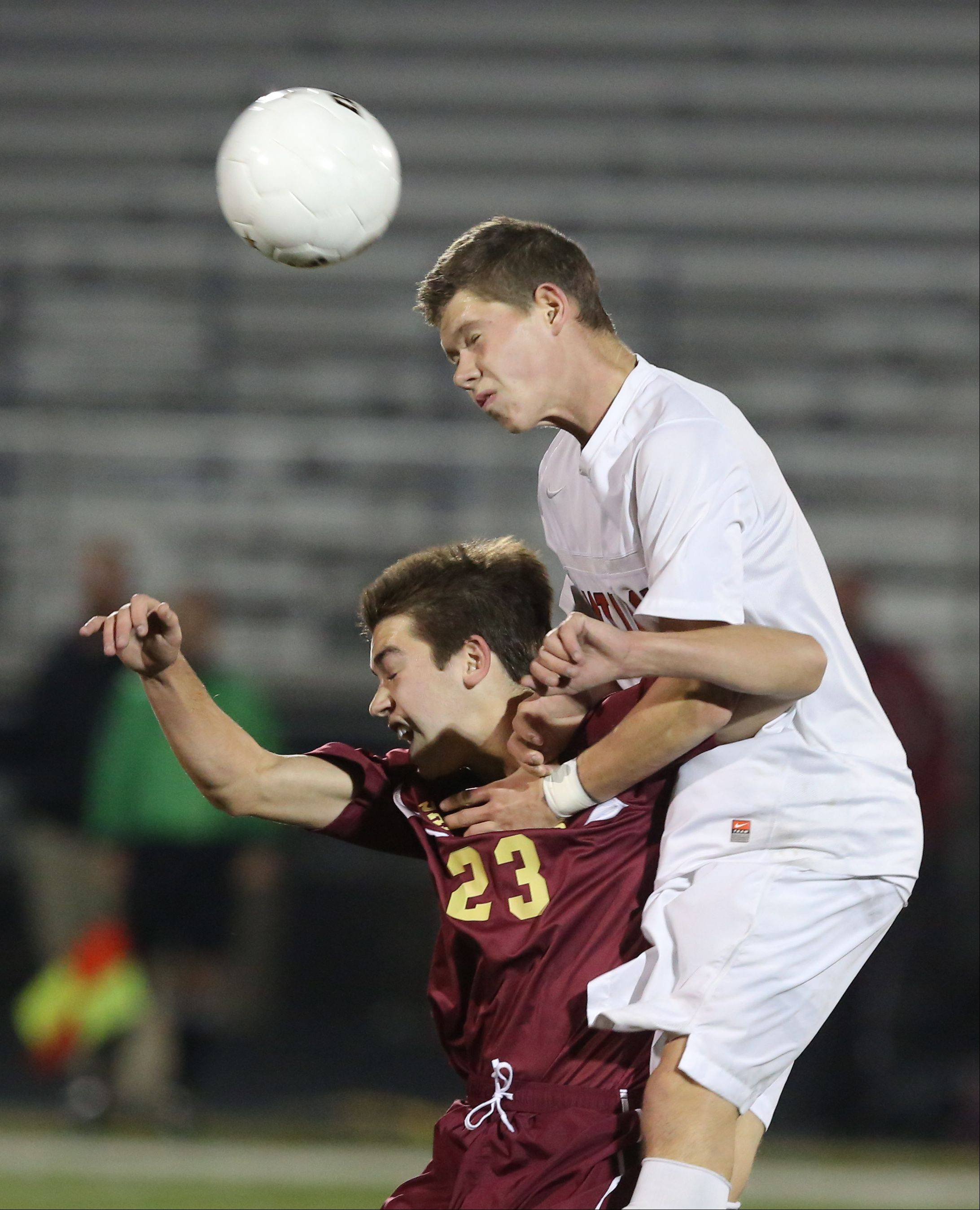 St. Ignatius' Matt Quaas, left, and Antioch's Krystian Streit go up for a header during the Class 2A supersectional Tuesday night at Stevenson.