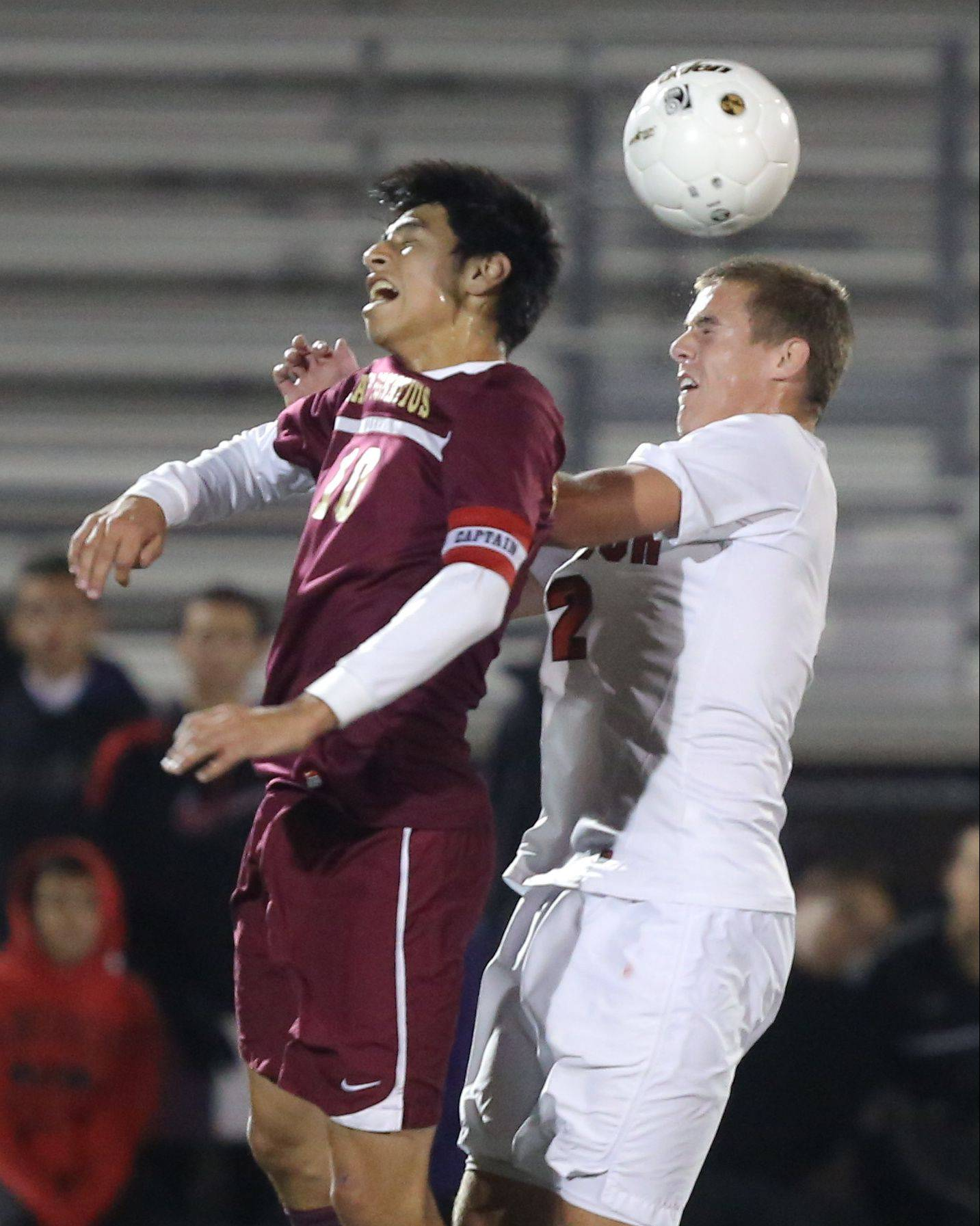 St. Ignatius' Marco Sanchez, left, and Antioch's Eric Pedersen go up for a header during the Class 2A supersectional Tuesday night at Stevenson.