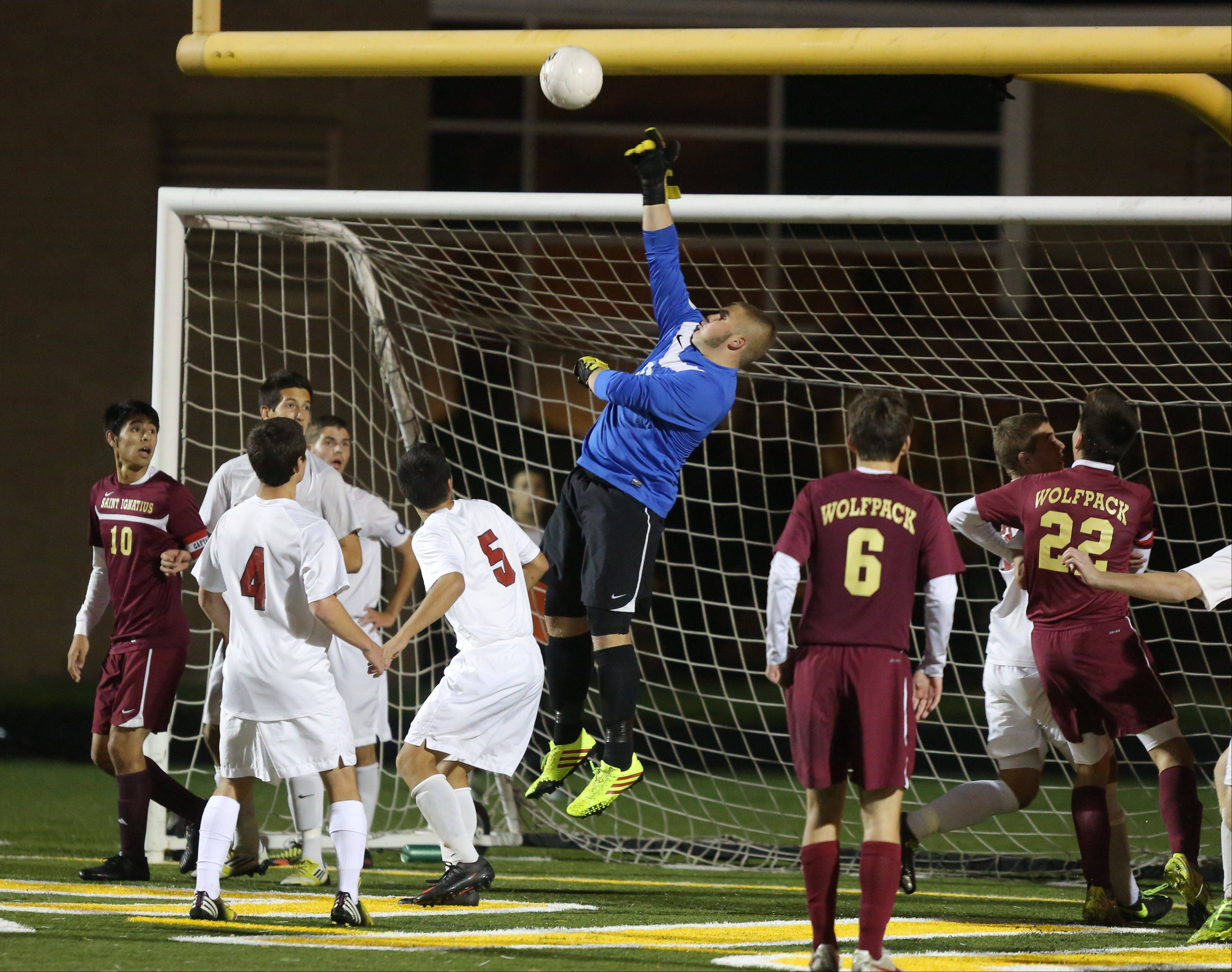 Antioch goalie Tommy Tritschler goes up high to make a save during Class 2A supersectional play against St. Ignatius on Tuesday night at Stevenson.