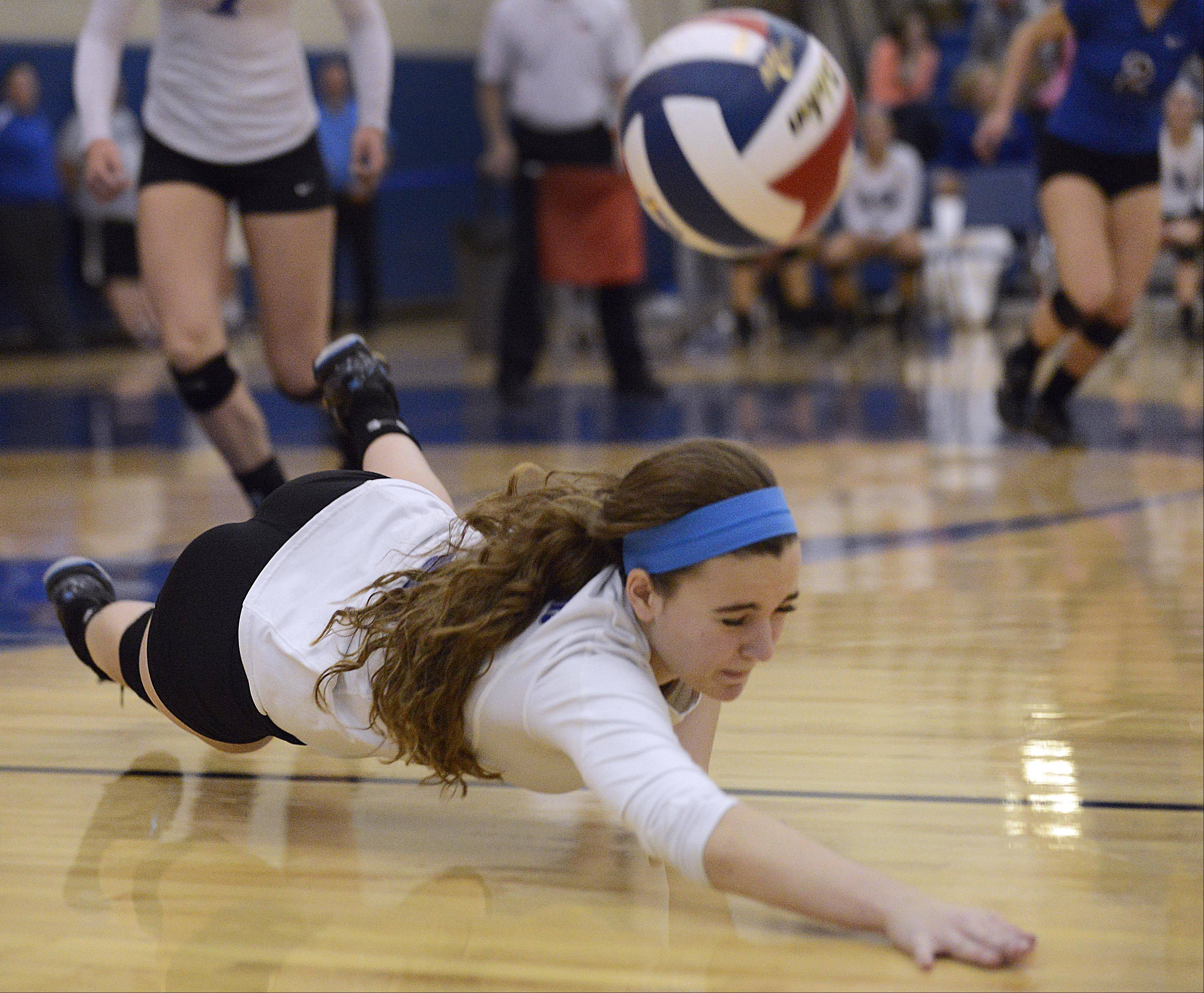 St. Charles North's Taryn DalDegan dives but can't get to a St. Charles East shot Tuesday in Geneva.