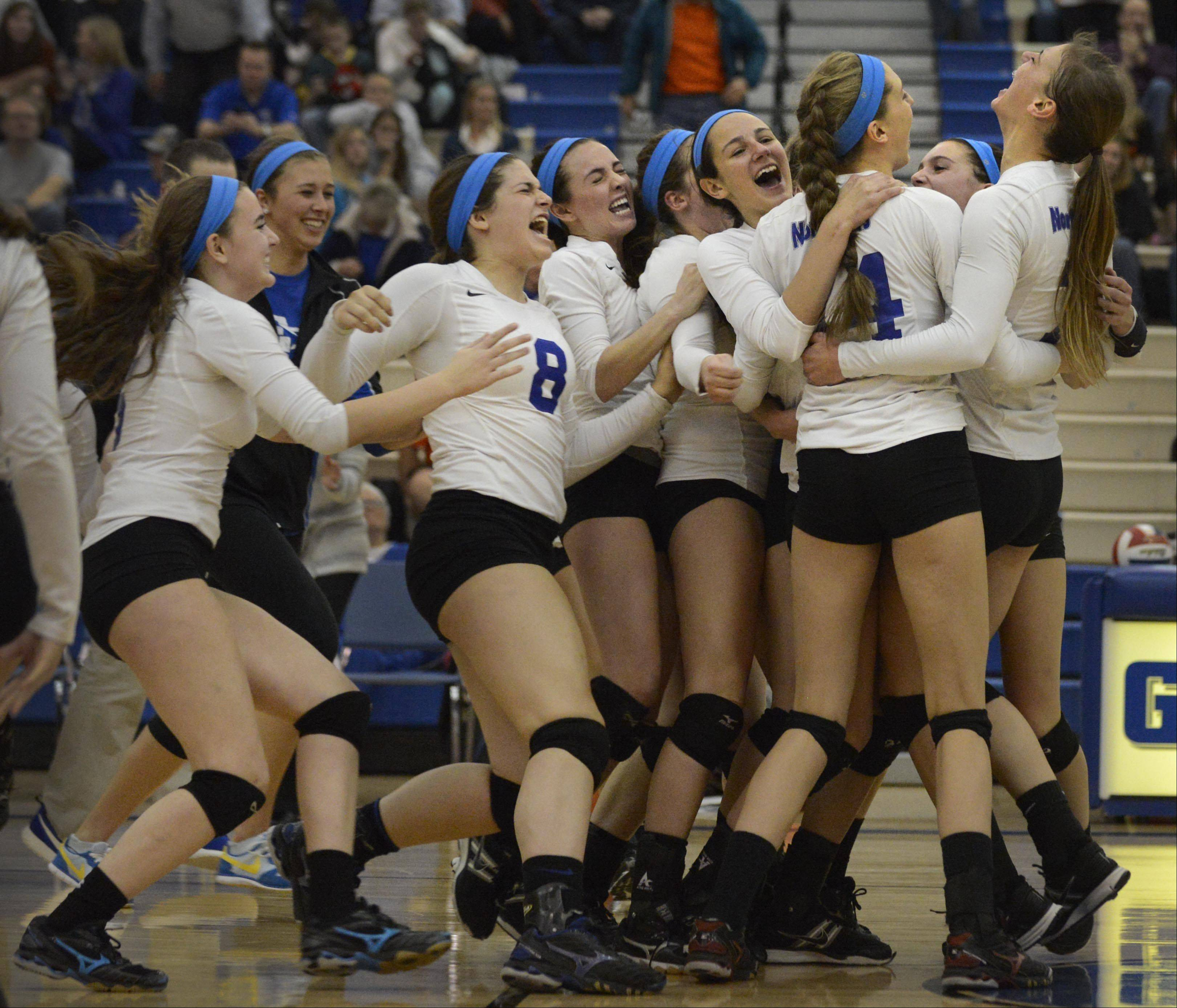 St. Charles North celebrates their sectional semifinal match win over St. Charles East Tuesday in Geneva.
