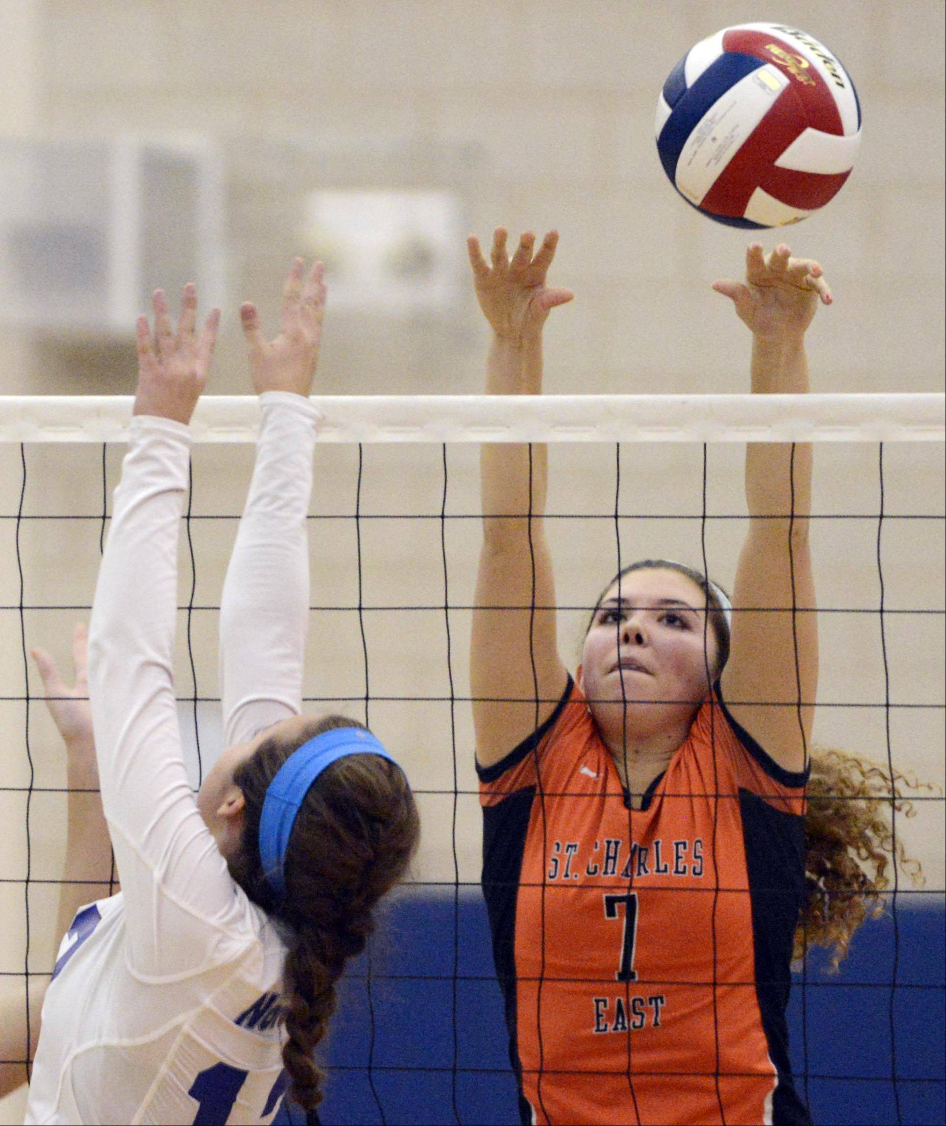St. Charles East's Meagan Smith goes up to block a tip by St. Charles North's Sydney Wohlert Tuesday in Geneva.