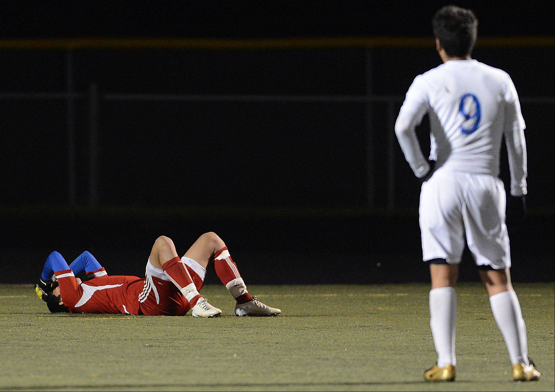 Larkin goalkeeper Aldair Dominguez lays on the ground after surrendering an insurance goal to put Lake Park up 2-0 with about 5 minutes to play during Tuesday's supersectional in Streamwood.