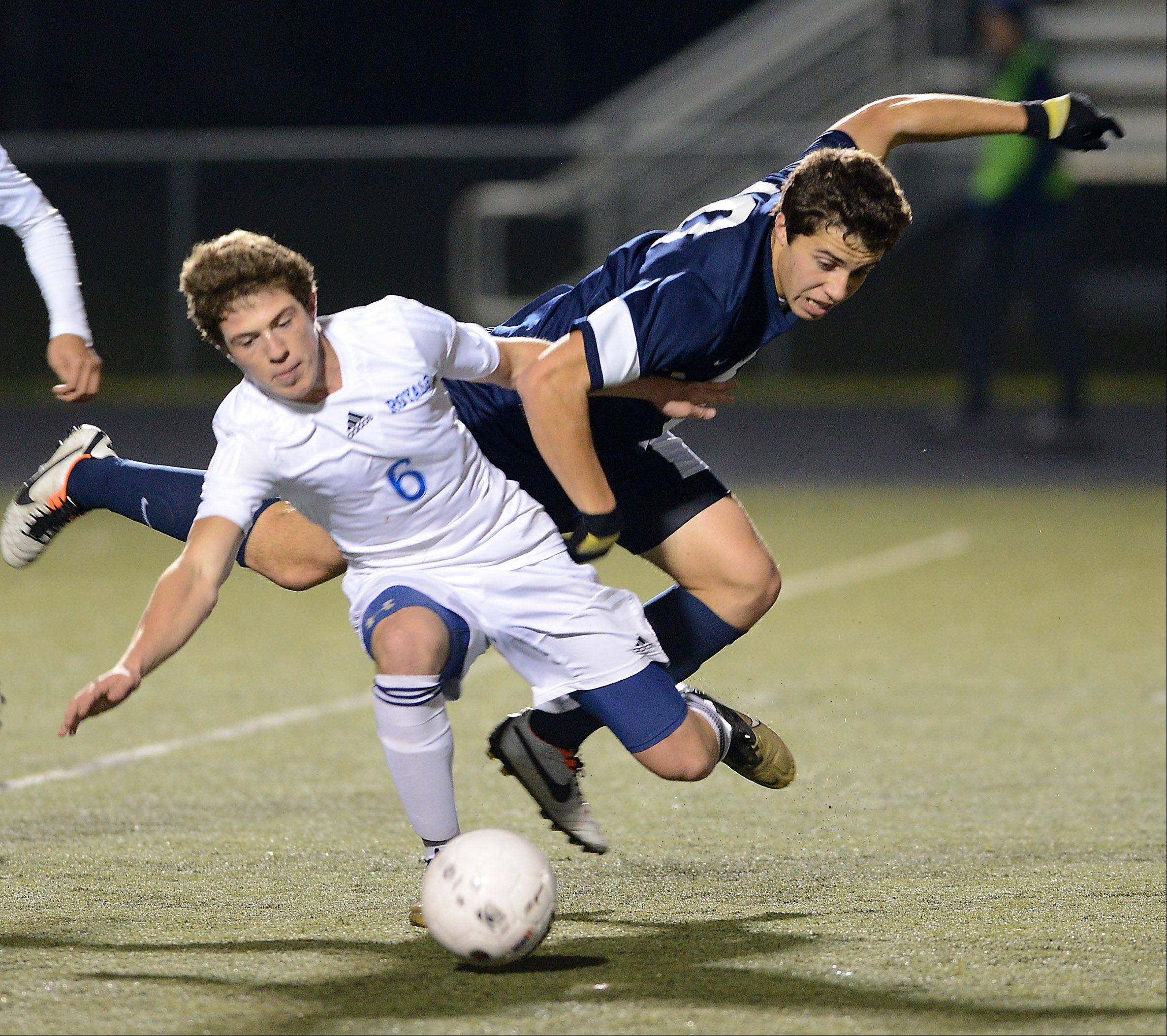 Larkin's Josh Garcia fouls Lake Park's Mike Catalano during Tuesday's supersectional in Streamwood. A rebound of Catalano's free kick was knocked in for the game-wining goal.