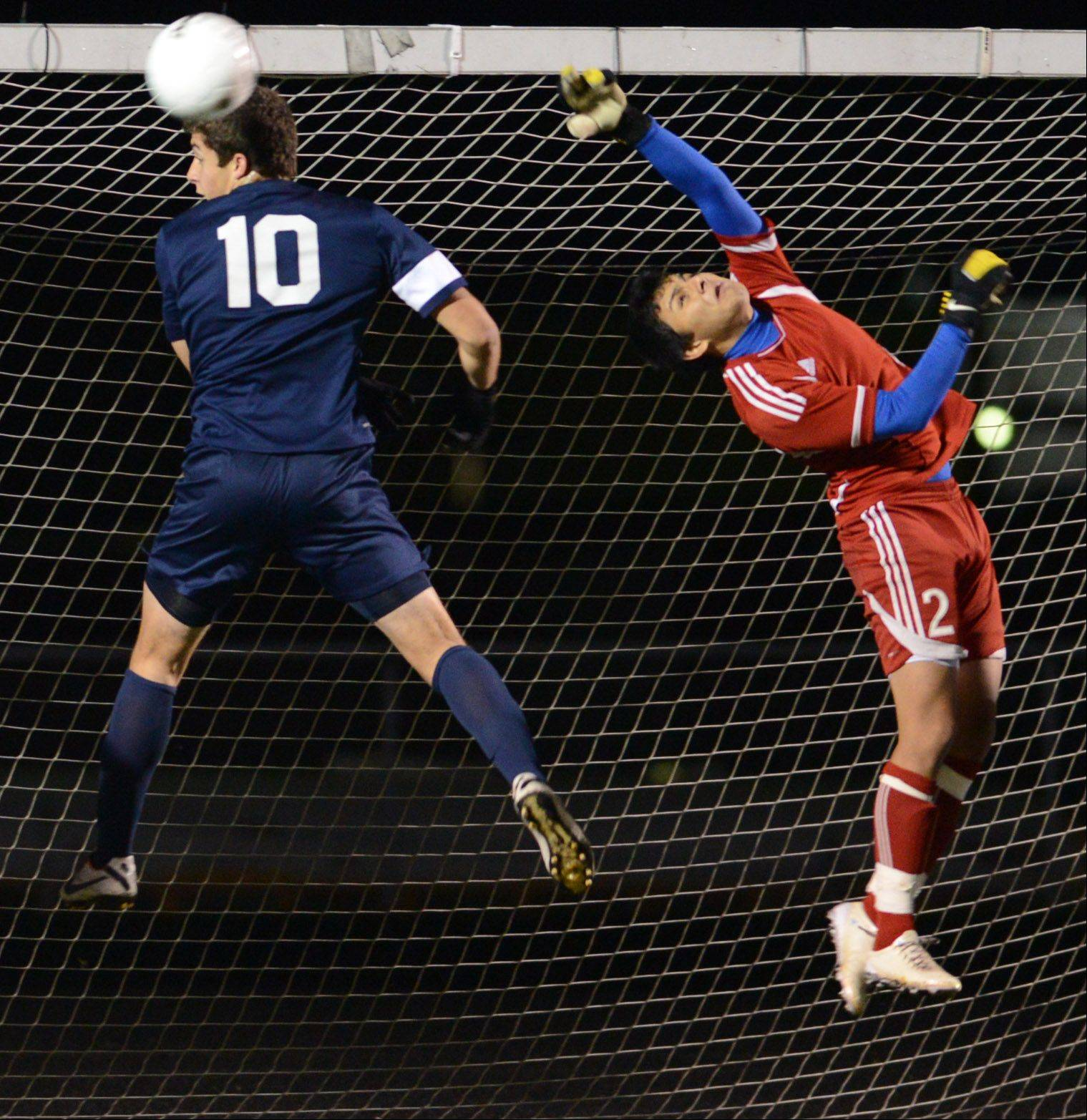 A corner kick sails past Larkin goalkeeper Aldair Dominguez and Lake Park's Mike Catalano during Tuesday's supersectional in Streamwood.
