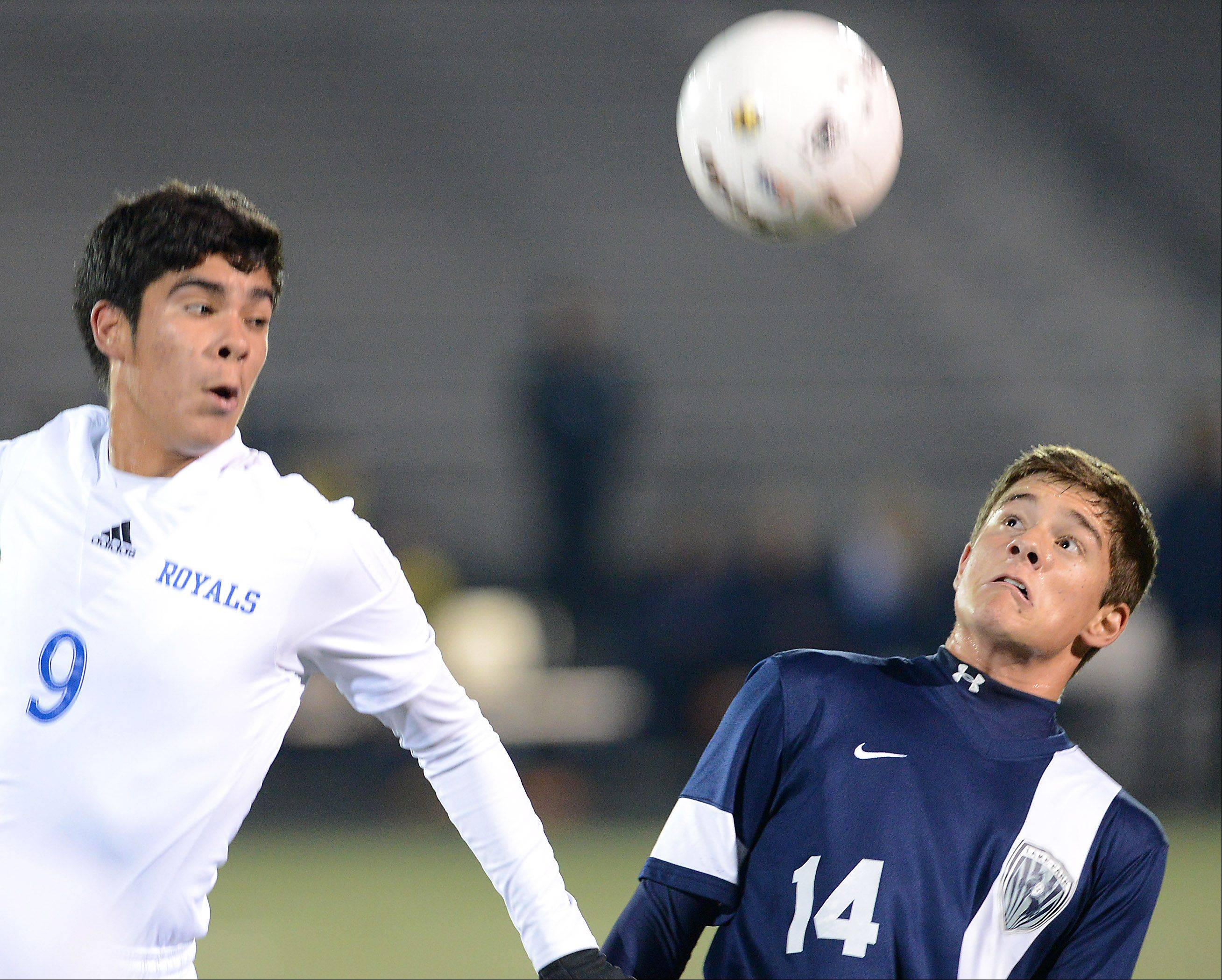 Larkin's Diego Ramirez and Lake Park's Freddy Alvarez go up for a header during Tuesday's supersectional in Streamwood.