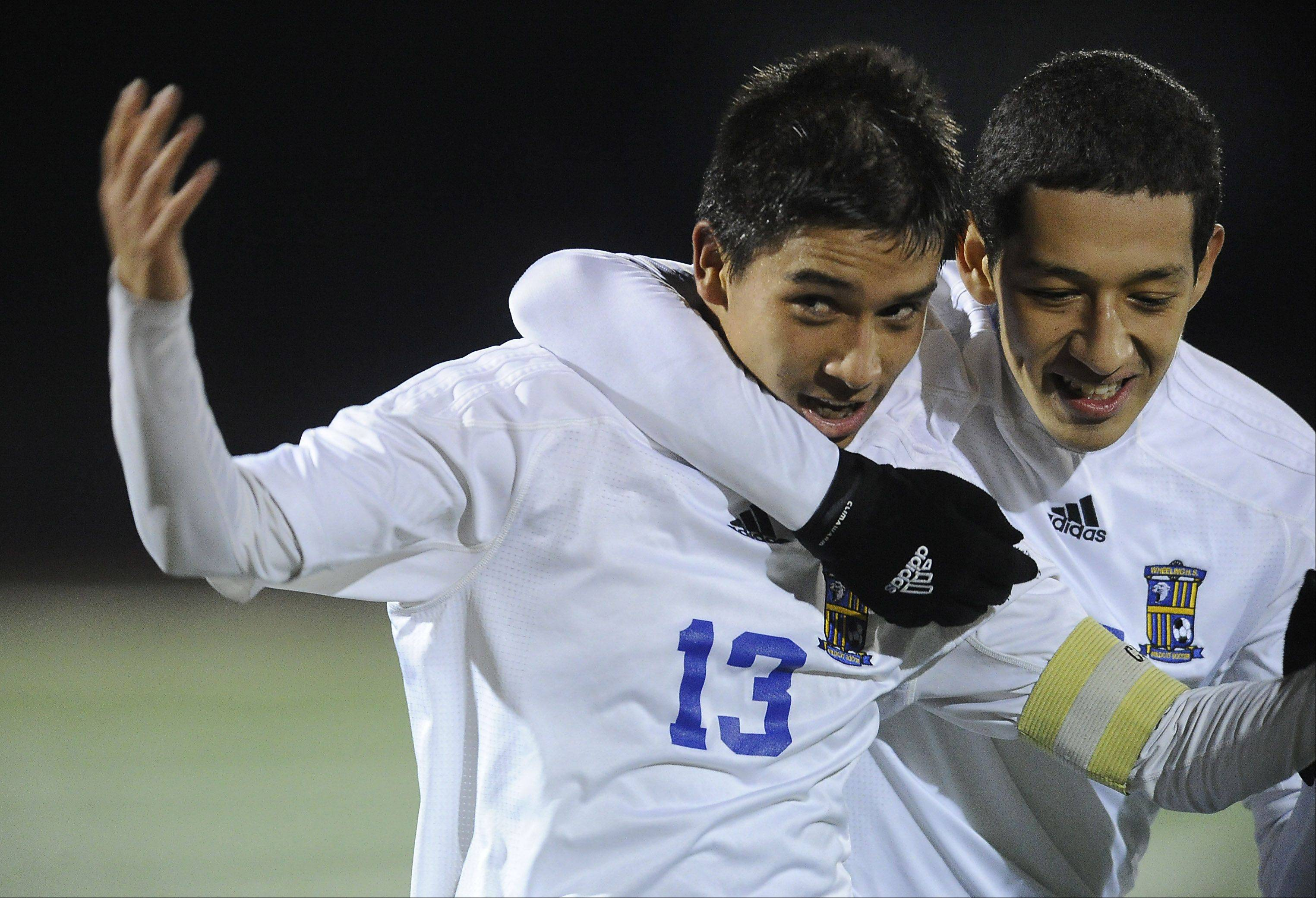 Wheeling's Jose Garcia and teammate Michael Hernandez celebrate a Wildcats goal in their 2-1 decision against Barrington in the Class 3A supersectional at Hersey on Tuesday.