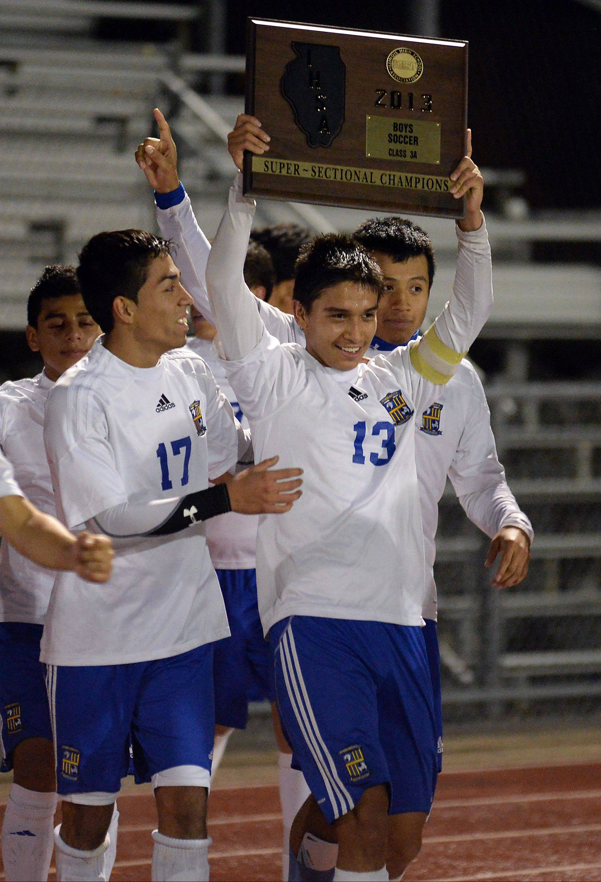 Wheeling's Jose Garcia and teammate Michael Hernandez celebrate their 2-1 victory over Barrington in the Class 3A supersectional at Hersey on Tuesday.